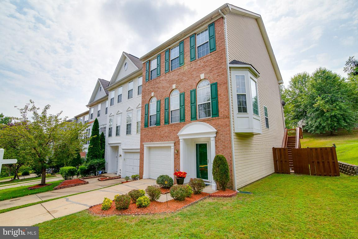 Elegant Three Level End Unit Brick Front Town Home with Garage. Expansive Entryway. Large Family Roo