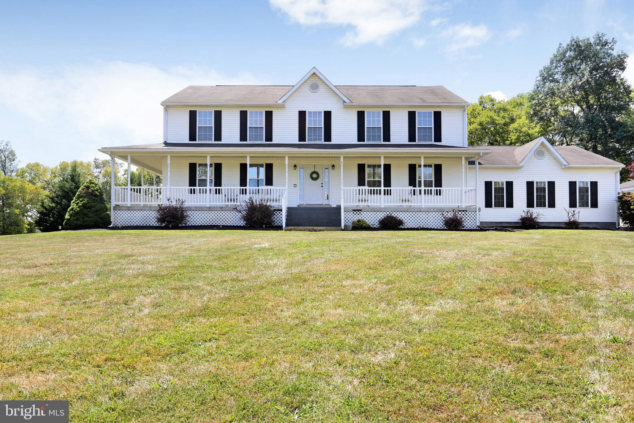 Country home on spacious lot with privacy and no restrictions- 5 br  3 1/2 ba--Hardwoods through out