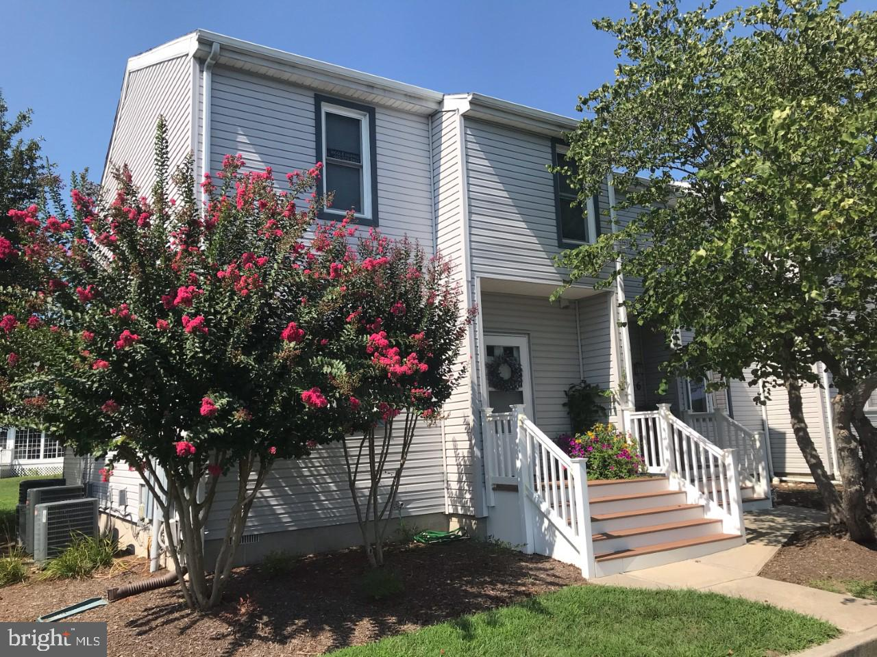 Bike to the beach from this coastal inspired 3 BD, 2 1/2 BA end unit town home that features a great