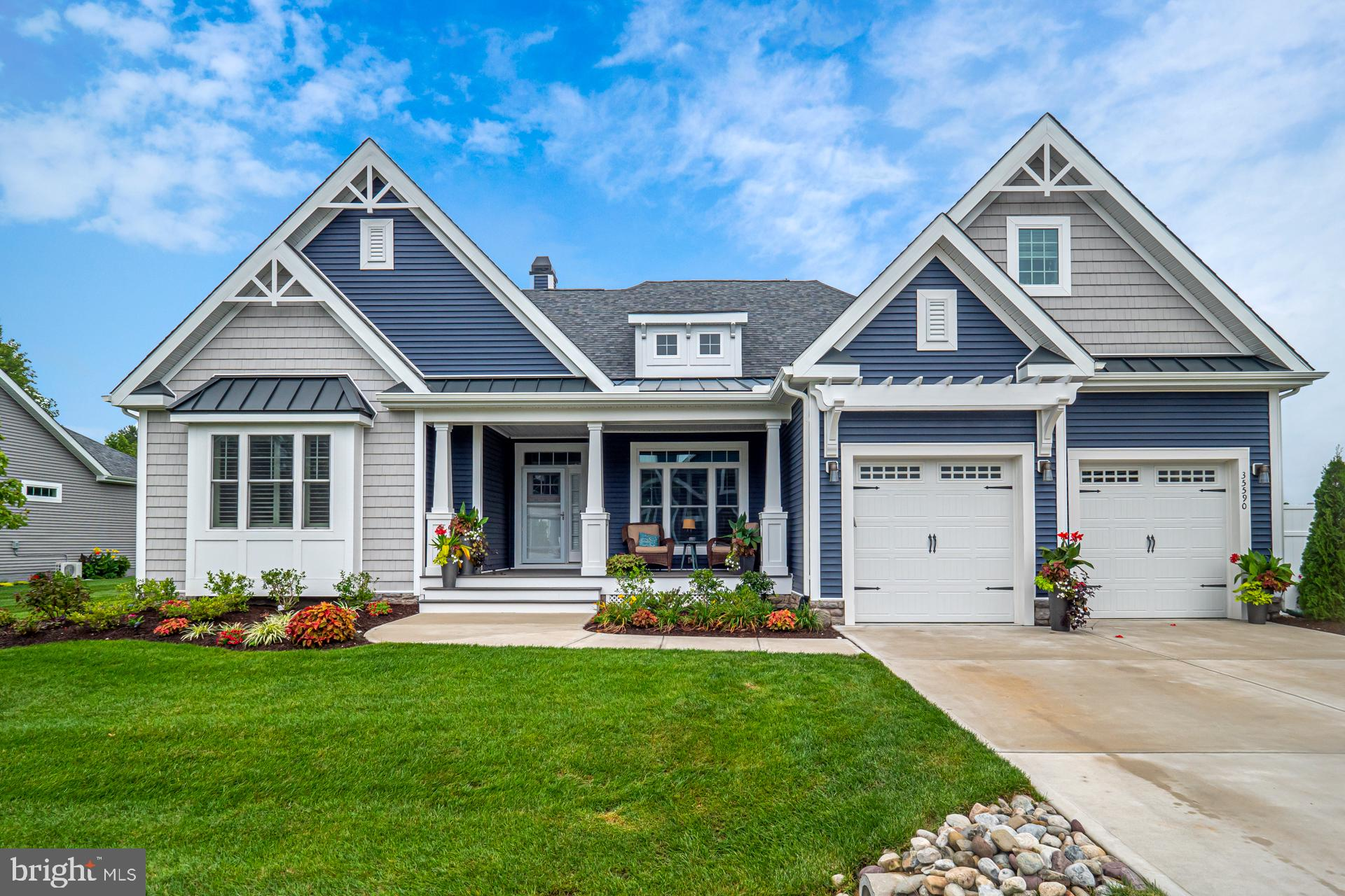 Come experience coastal refinement in this exquisite two-year young home in the gated community, Saw