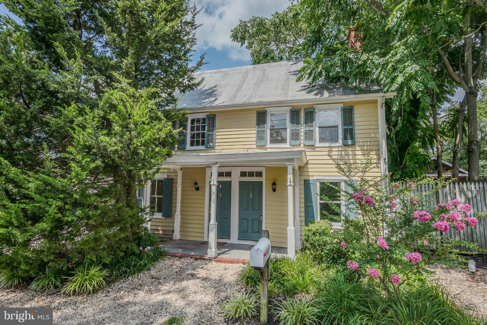 Centrally located in the heart of Milton, this colonial-style home is situated on a spacious corner
