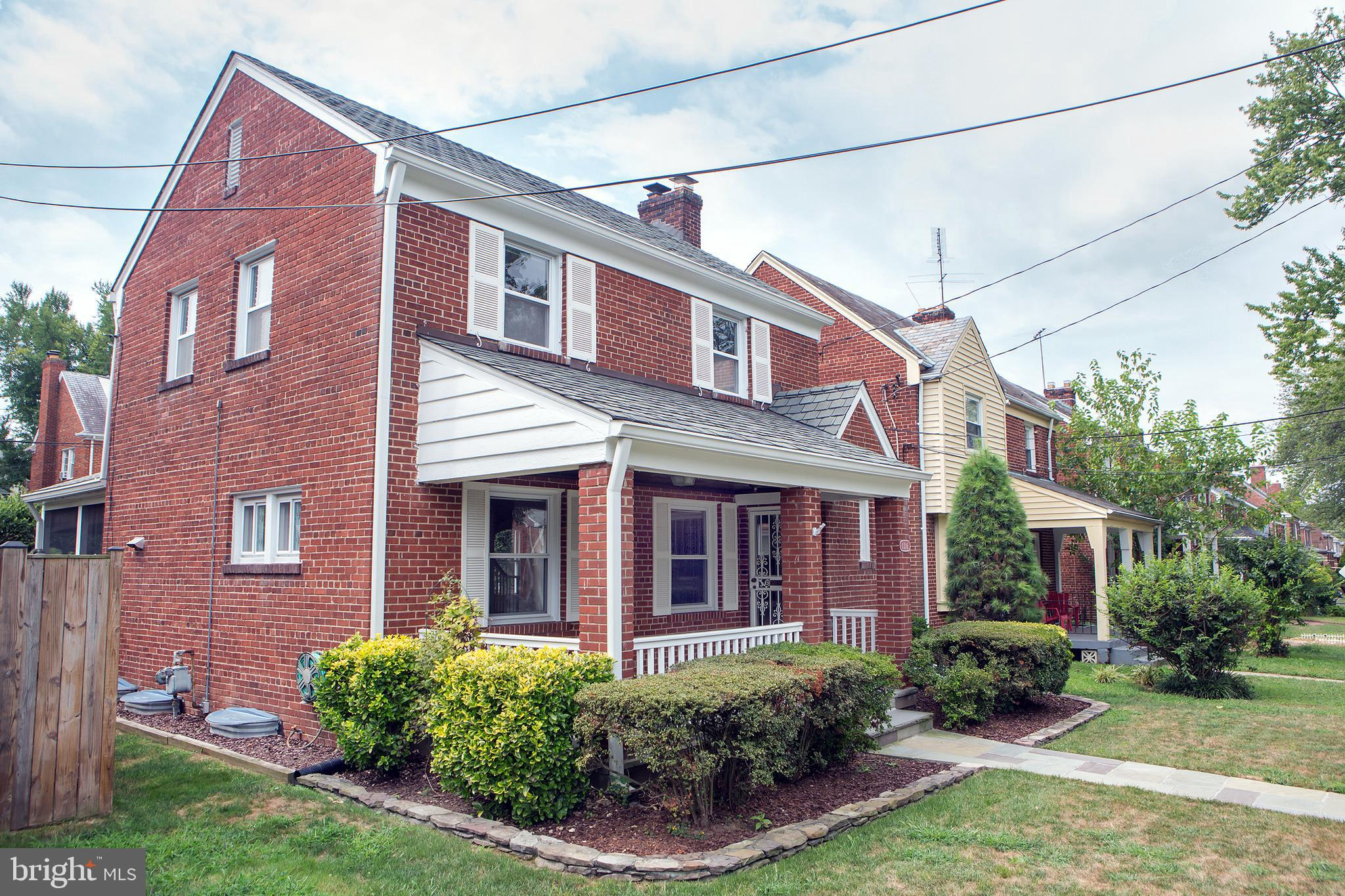 NEW LISTING! Solid Porch-front Colonial Starter Home in Booming Brightwood! Well maintained 3BR/1.5B