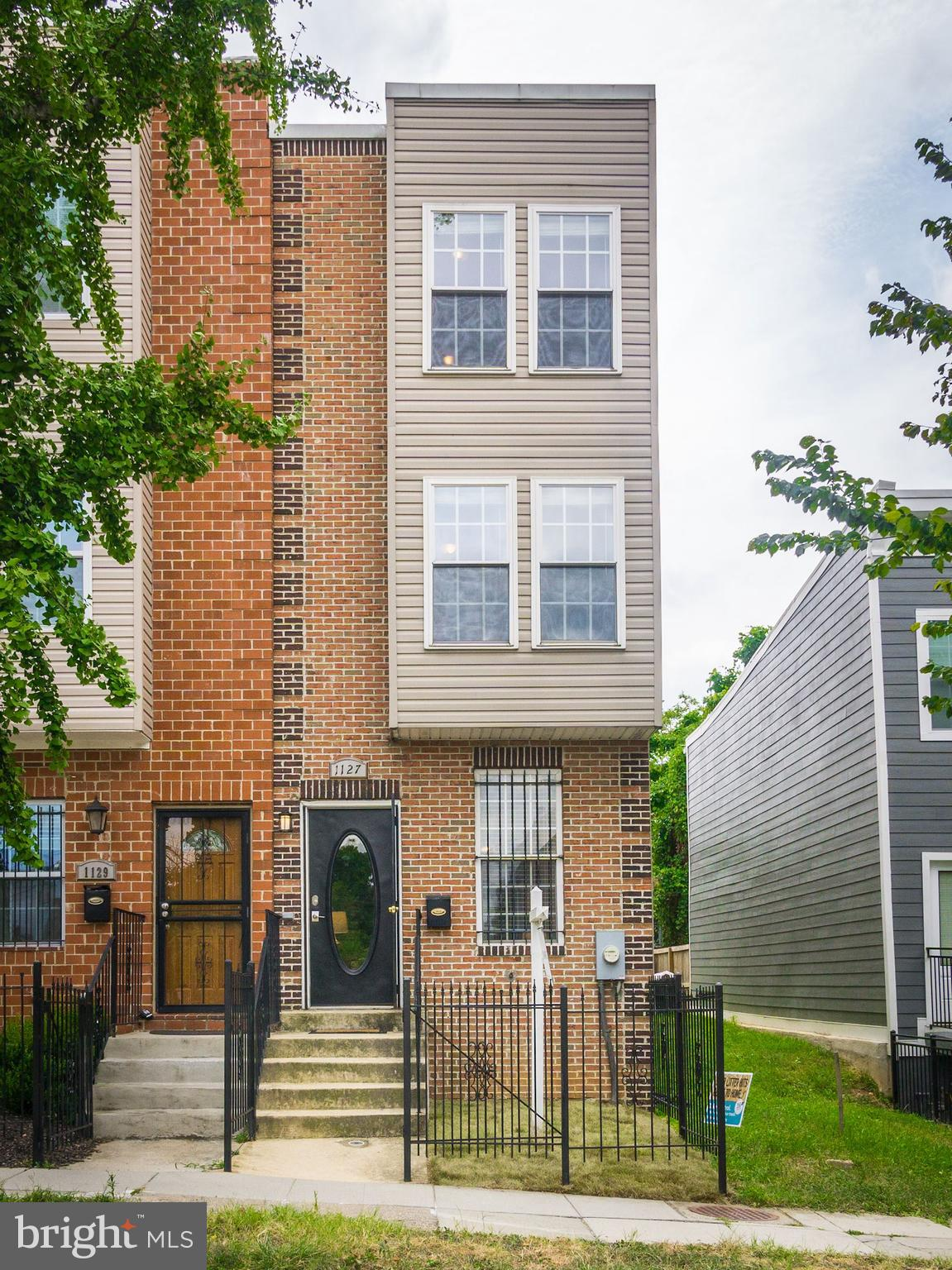 Beautifully & Newly Updated end-unit row home in DC's Exciting Trending Trinidad neighborhood! Open