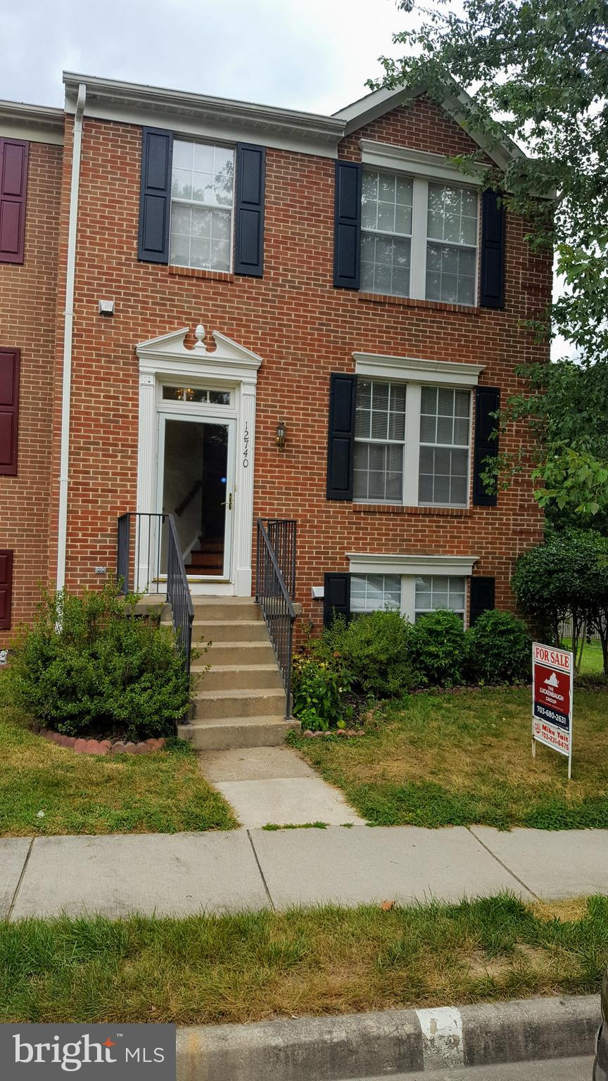 Vacation at home! This brick front and side end unit townhome is located in the sought after Lake Ri
