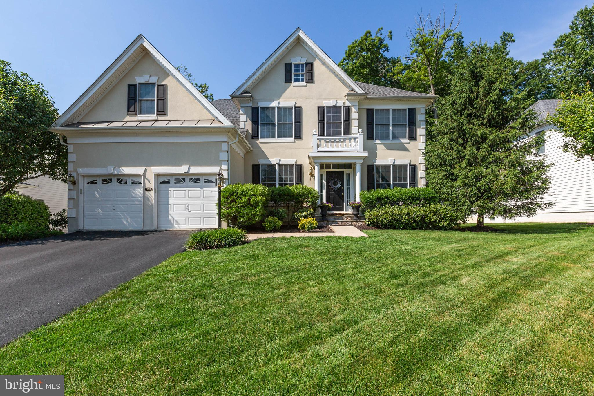 Gorgeous Ellsworth model~5,208 sq feet  4 bedrooms & 3.5 baths with an amazing 18 X 36 heated inground pool and hot tub~ Private tree save on .30 acre fenced lot~ Upgraded 24 X 24 tile in Kitchen, Laundry and morning room ~ Gourmet Kitchen with custom stone/glass back splash, Granite counters, Stainless Steel appliances, Cherry Cabinets, Breakfast bar and table area~ Wall of windows in Sunroom overlooking pool~ Large family room off Kitchen with gas fireplace surrounded by windows~ Main level office~ Upper level boasts huge master retreat with tray ceiling, sitting area, walk in closets and luxurious master en suite~ Spacious additional bedrooms with hall bath~ Finished lower level with full bathroom, ntc bedroom or den/playroom~ Recreation area and walk up stairs to wonderful back yard~ 1 yr old Roof!!~ This home has been meticulously maintained! The community amenities include security and gated access, outdoor pools and indoor pool, exercise room, club house, tennis courts, basketball courts, tot lots, miles of walking/biking trails and much more.  Two Arnold Palmer Signature Golf Courses. Easy and quick access to major commuter routes 15, 29, 50 and I-66 and new commuter bus service.
