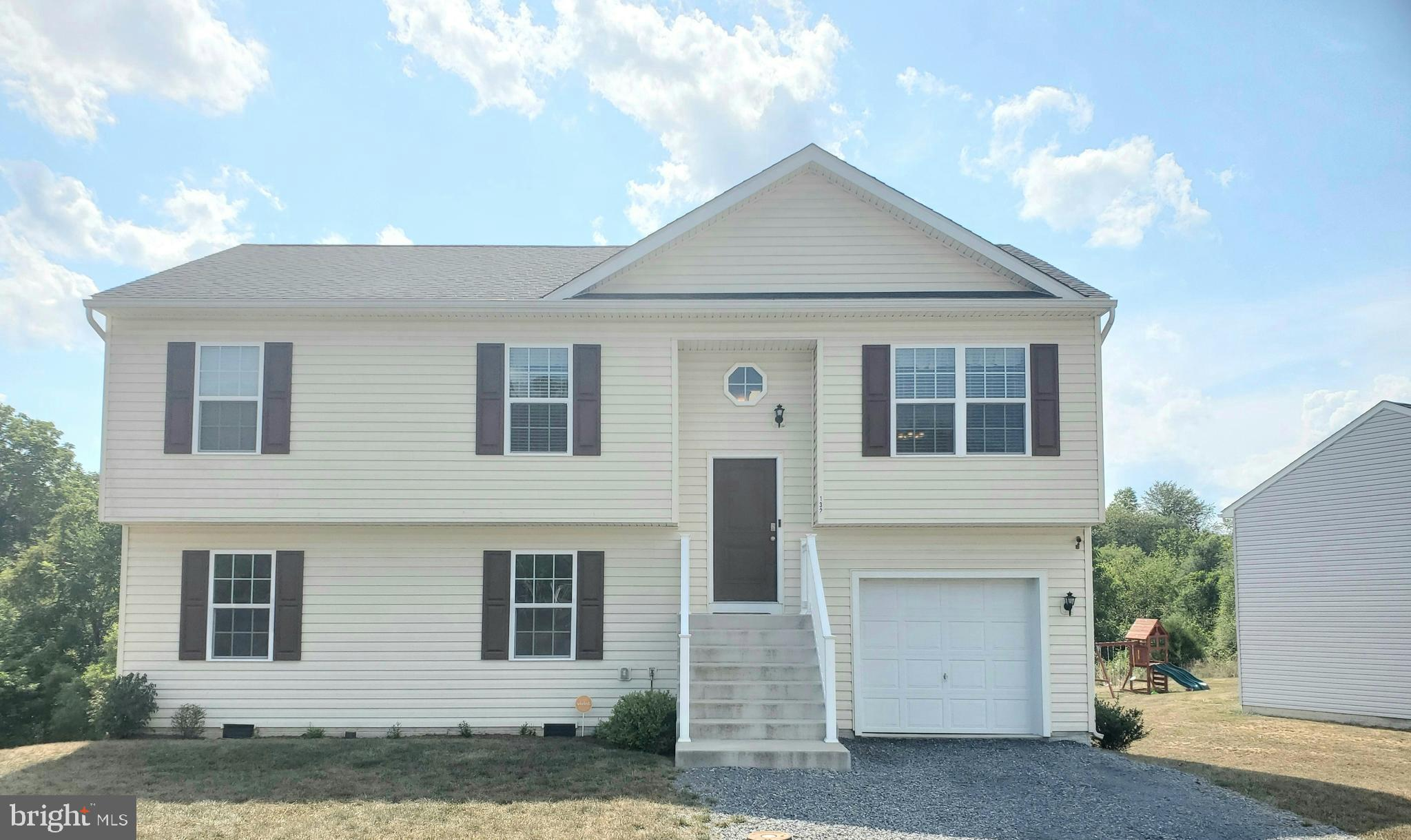 Less than 3 years old, this shows beautifully.  Offering 3 bedrooms, 2 full baths, living room with