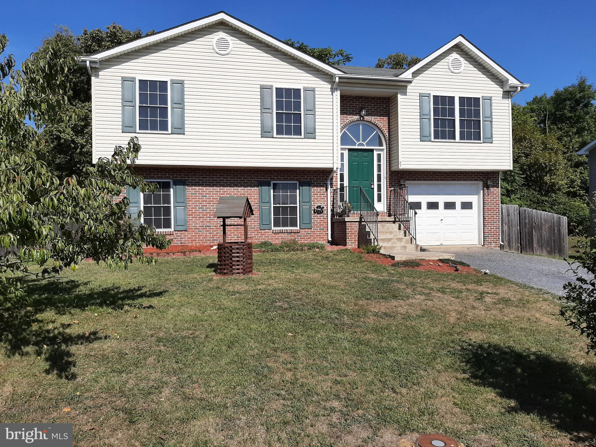 Come see this freshly painted 3 Bedroom 3 Full bath home , fenced yard, fruit trees man made pond &