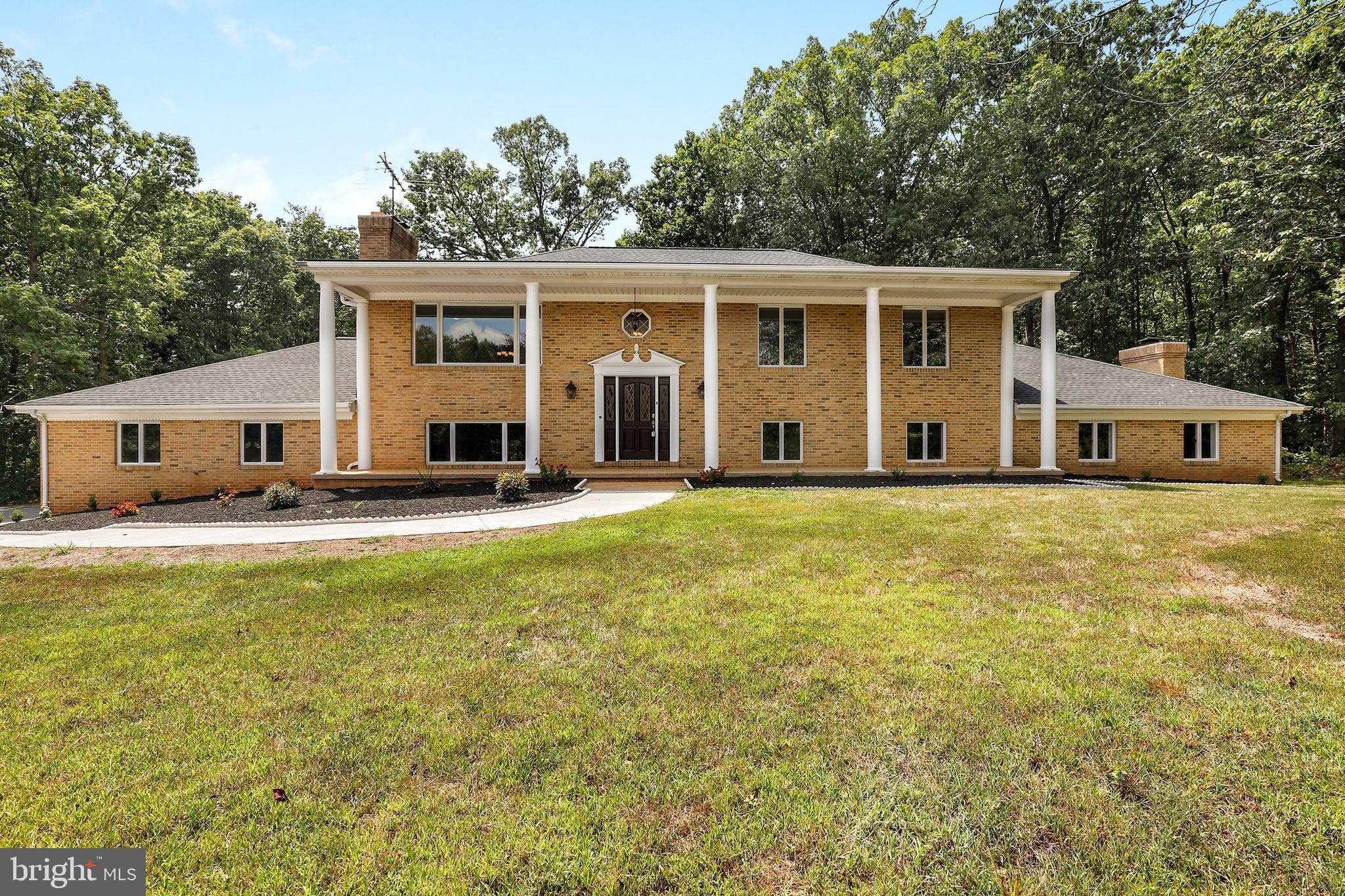 Move right in! This custom home in Haymarket seated beautifully on a cul-de-sac with a 4+ acre priva