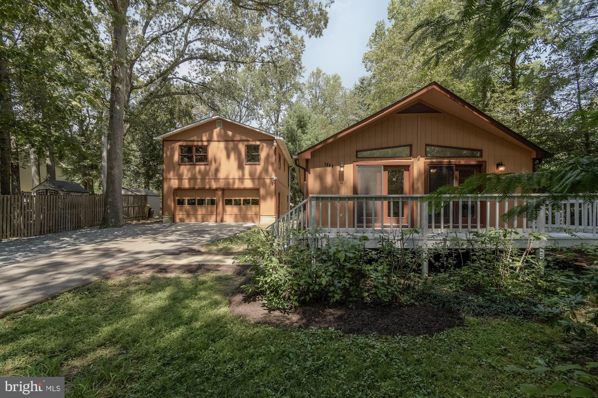 Beautifully renovated home with 3 bedrooms and 2 full baths, surrounded by shade trees. Expansive fr