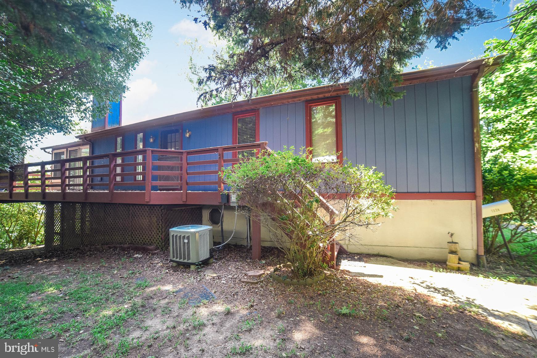 Waterfront rambler with 3 bedrooms and 3 full baths.  Home has large wrap around deck, sunroom and s
