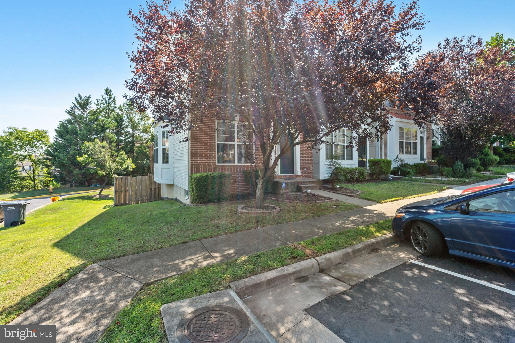 Sumptuous Brick Front Townhouse end Unit-Corner Lot with Spacious Deck- Fenced Back Yard-Hardwood on
