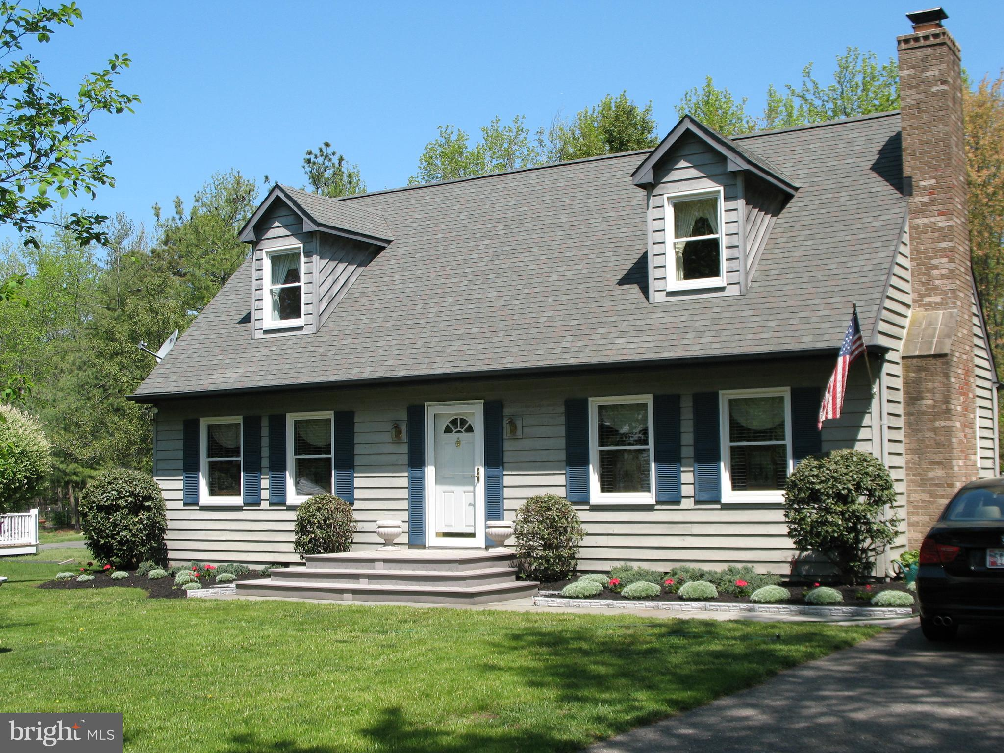 Family memories can be made here! Charming Cape Cod featuring 4 bedrooms, hardwood floors,    awning