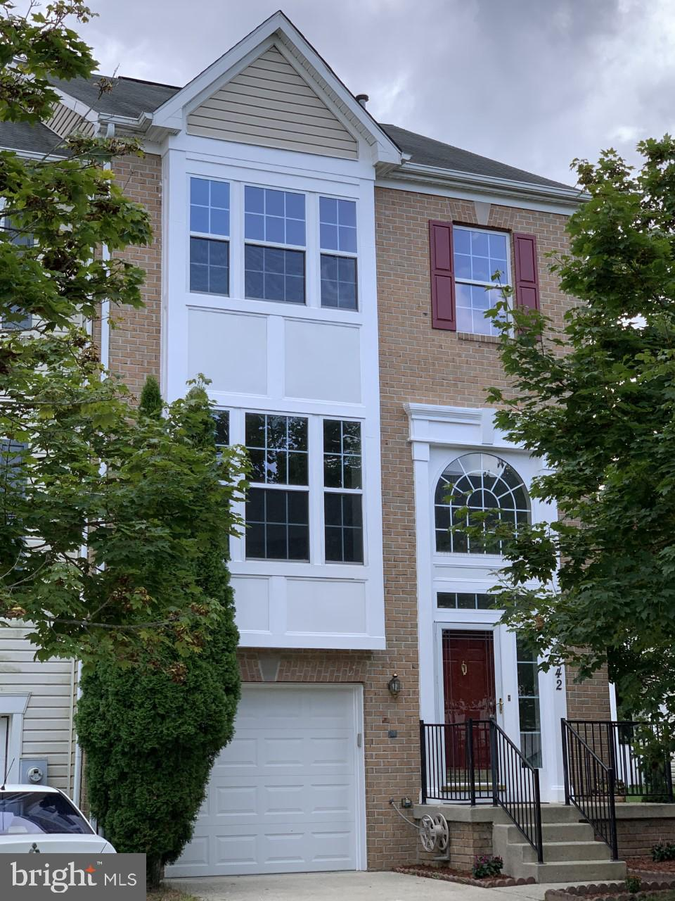 Elegant End unit Town House in absolutely move-in condition. Imposing brick front TH with front gabl