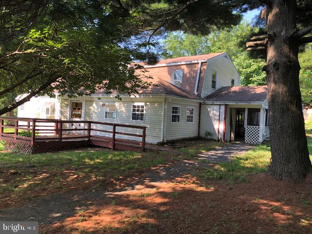INVESTOR OPPORTUNITY!  UNIQUE 1.7 ACRE PROPERTY FEATURING A 3,400 SQ. FT. HOUSE, DETACHED GARAGE, &
