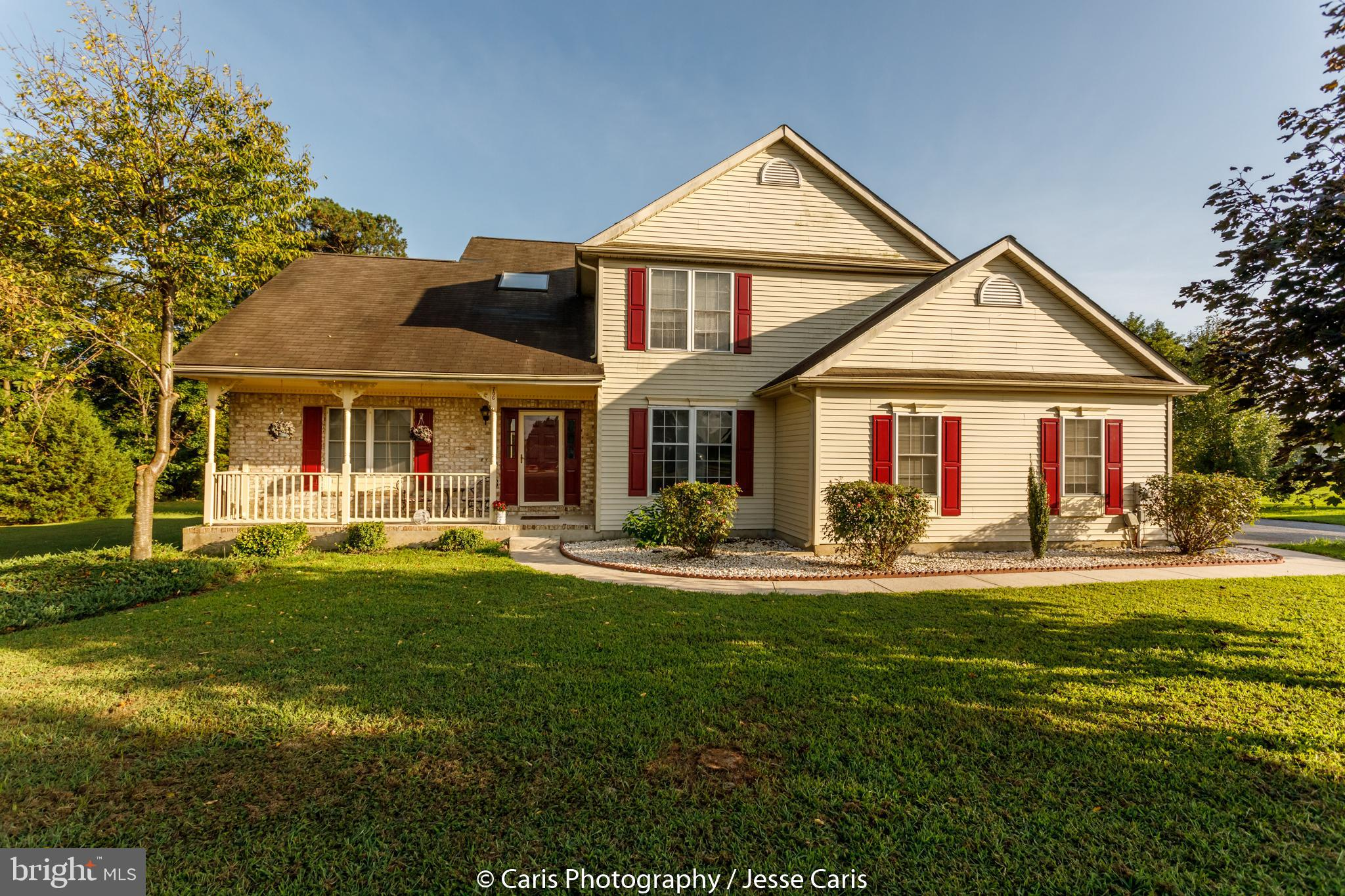 This lovely home sits on 1.3 acres with a back drop of woods that borders the branch of Marshalls Po