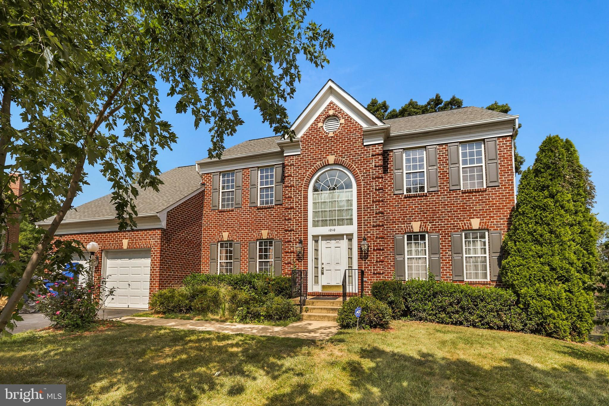 This lovely brick front estate home is located on the back of a private cul-de-sac with only 8 homes