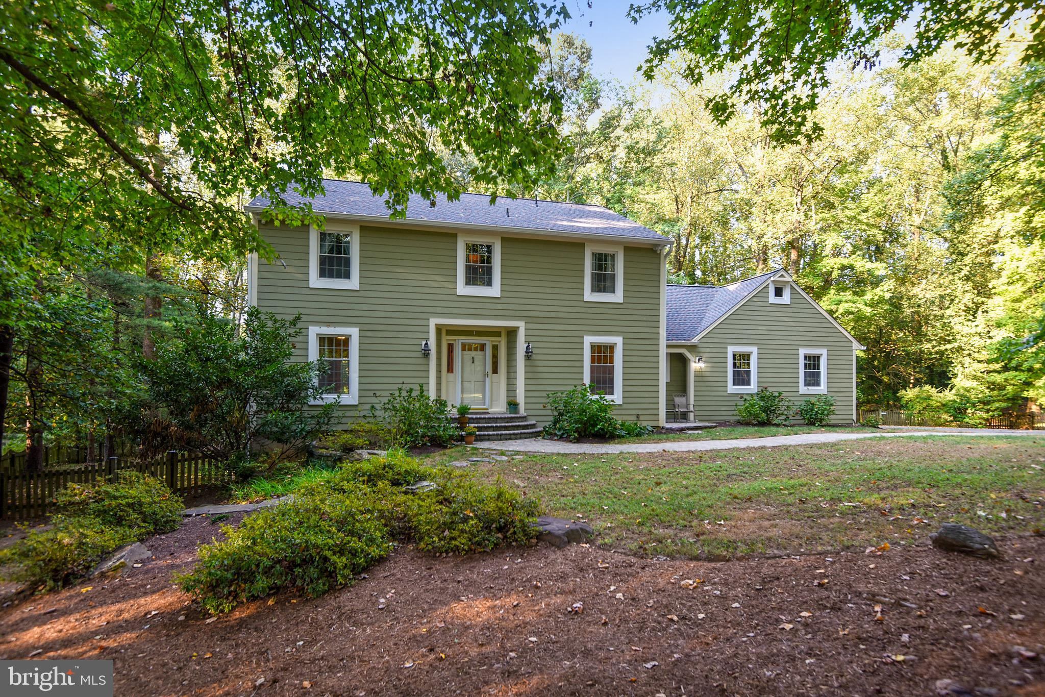 Elegance starts at the curb with this beautiful Saltbox Colonial in the sought-after neighborhood of