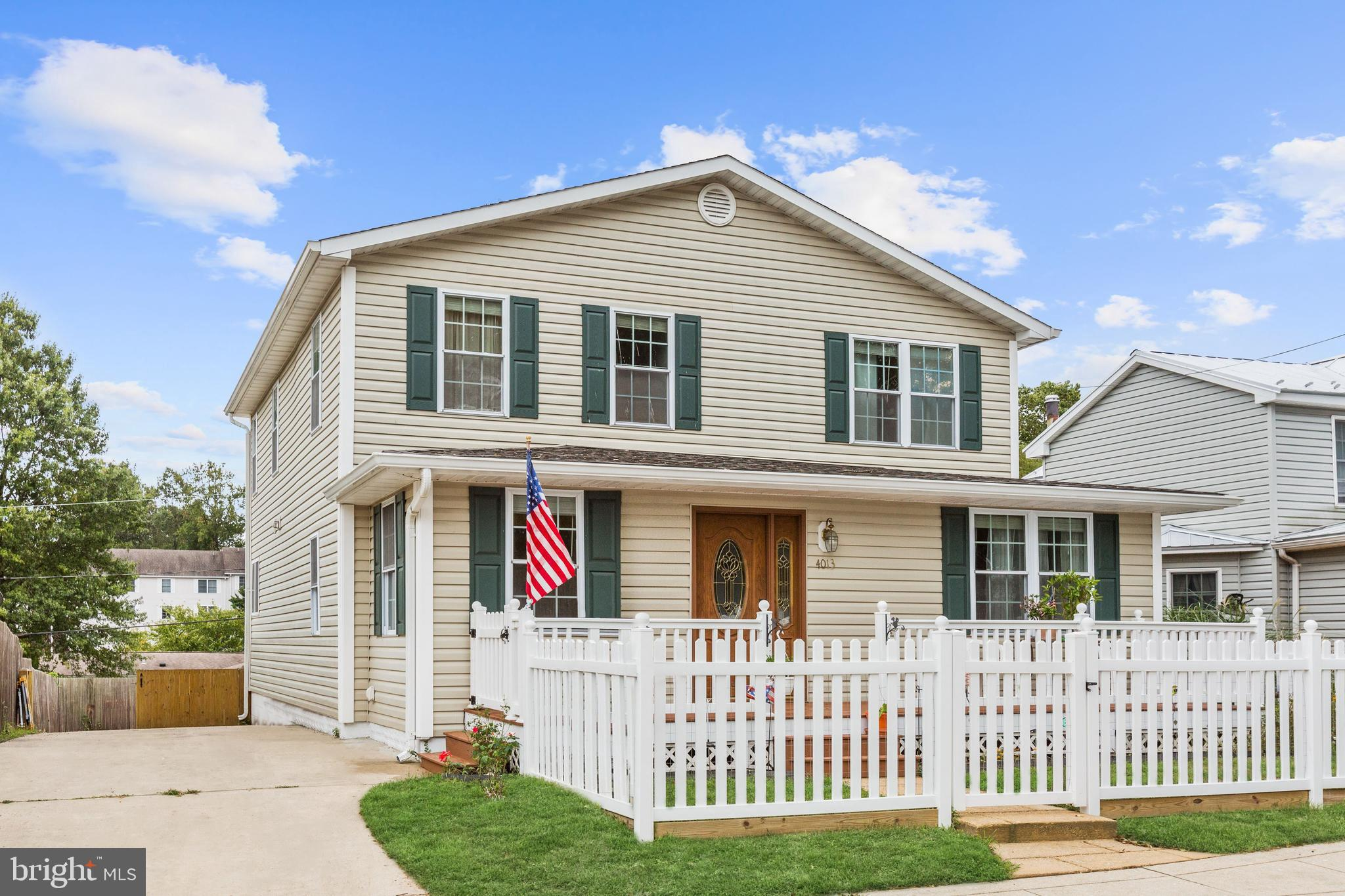 Just steps to the beach and boardwalk, this timeless home is filled with classic charm and upgrades