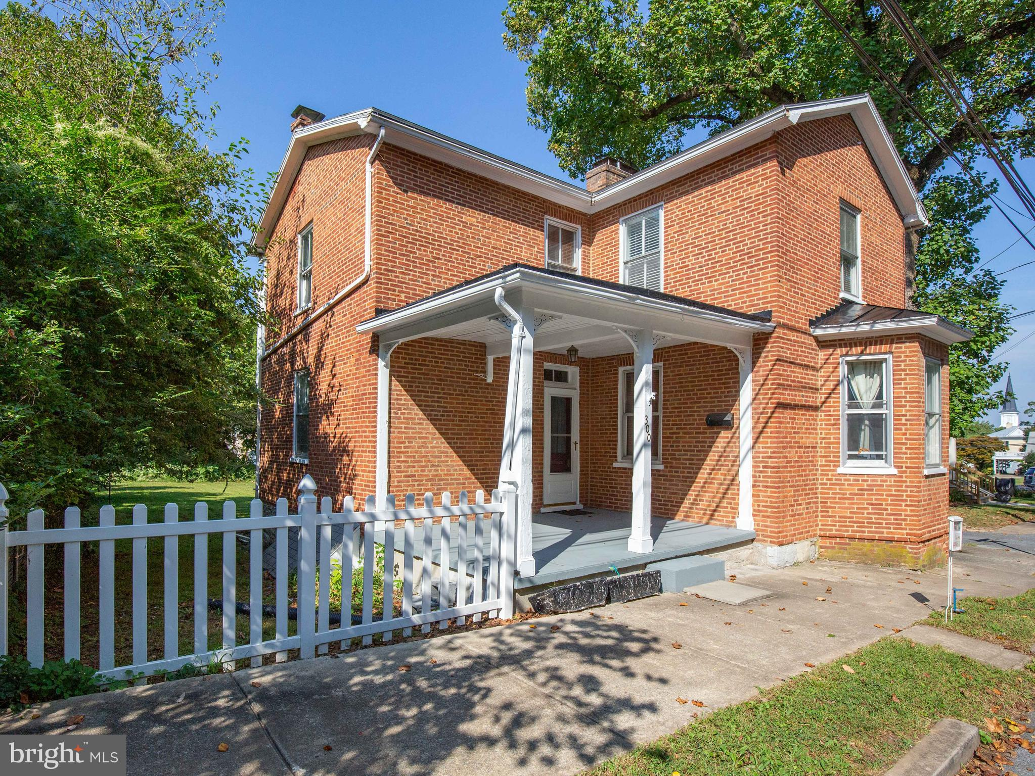 Charming brick home in the heart of Charles Town with all you would expect from a well-preserved 187