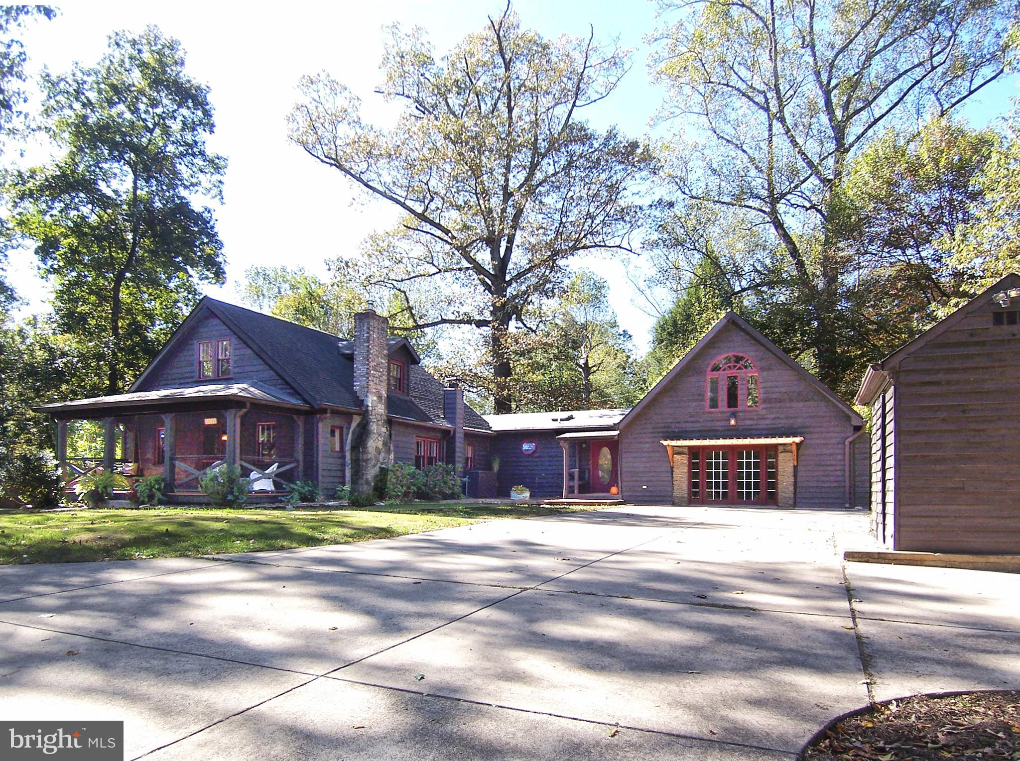 Charm, charm, charm! This turnkey, original 1939 expanded and remodeled Cedar and Log Home, offering
