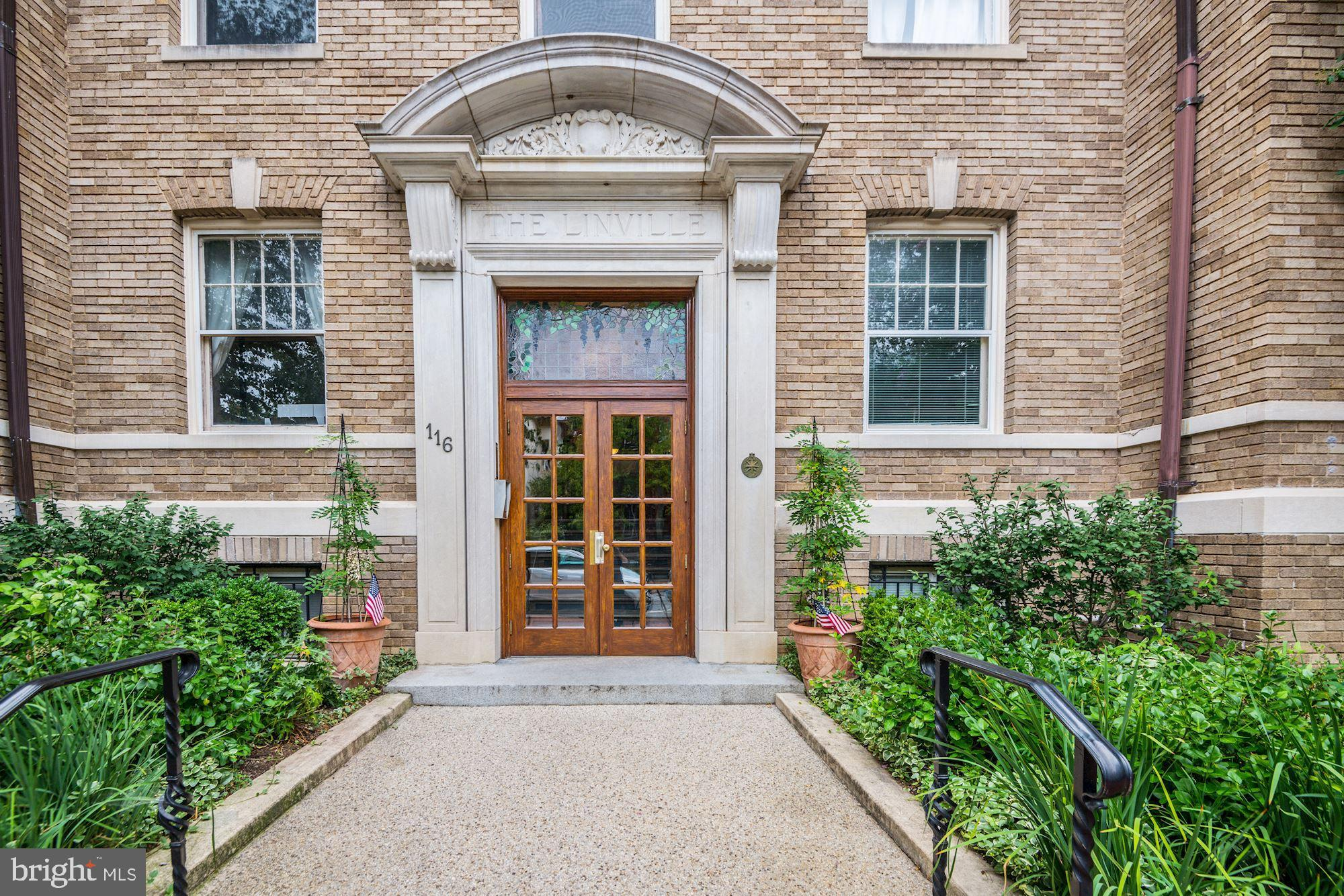 BUY YOUR NEW HOME FOR THE HOLIDAYS.  OPEN HOUSE SUNDAY 12/22 1-3 PM  Check out the virtual tour by clicking the movie icon. Capital Hill at its best, blocks from everything, Eastern Market, Eastern Market metro, the Capitol, restaurants, this home has original fixtures, flooring, tall ceilings, windows, and trim work.  The master includes a wall of built in closets, drawers, shelving tastefully done, AND a walk in closet.  Three additional huge closets in the unit, Bar Stools and separate microwave conveys, easy to use laundry in the basement. Second Bedroom can fit queen bed, and public records indicate it as a bedroom, but no closet.  Pictures have both with Queen bed and without.  Charming art deco brick building with 17 units.