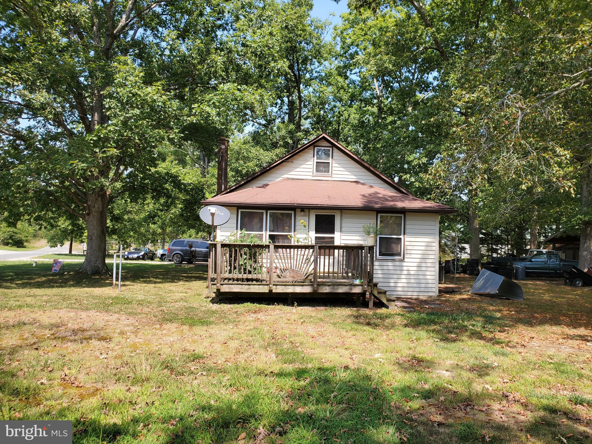This quaint home was previously used for the share croppers. Plenty of room on the 1.16 acres to expand the house or build a new one! The garage is 24'x24' and can hold 6 cars stacked side by side. The garage is wired for an air compressor & for the generator for the house. (air compressor & generator do not convey) The driveway has been reinforced to be able to withstand the weight of a large pickup truck with a large enclosed trailer. Third party approval required.