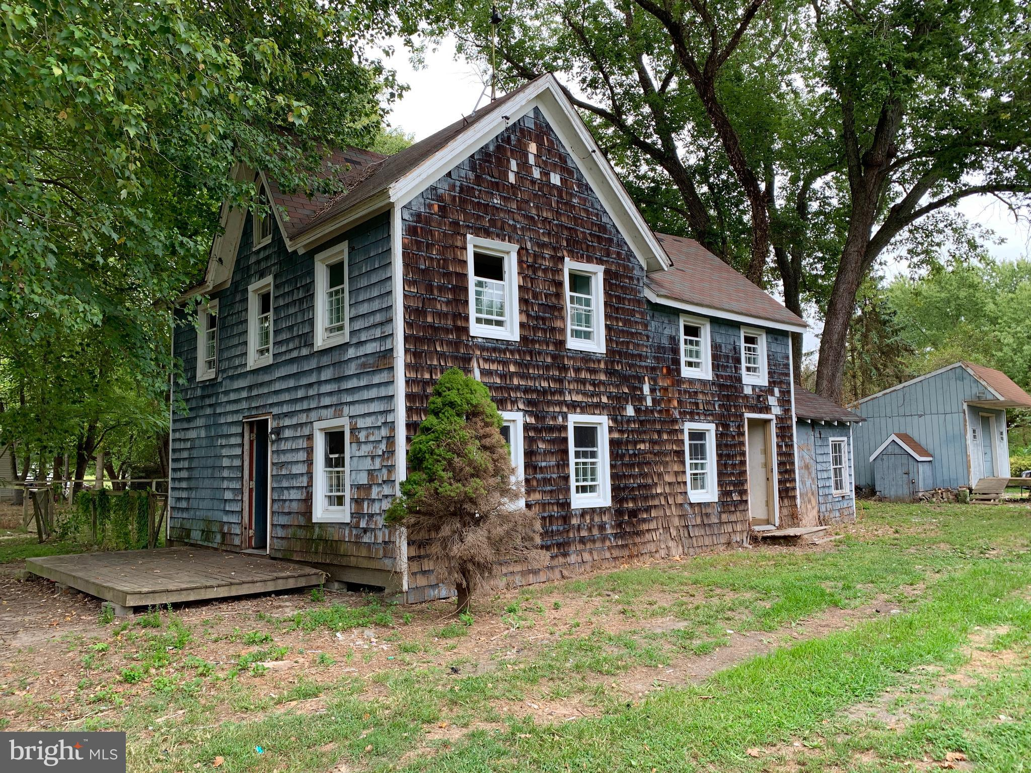 Investor alert! Old farmhouse on .55 acre corner lot! Fixer upper with a ton of potential!