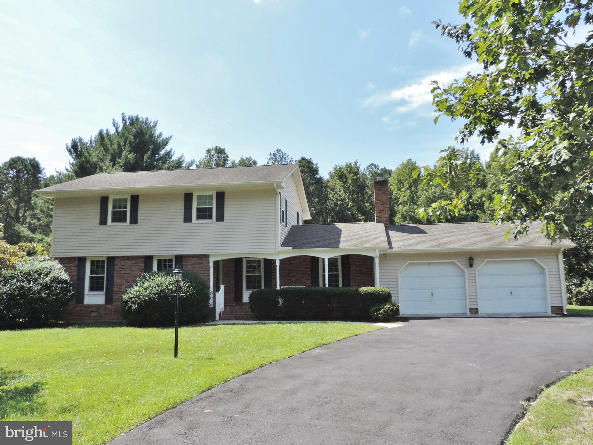Updated 4 bedroom Colonial with In-Ground Pool! Check out this immaculately kept home located just o