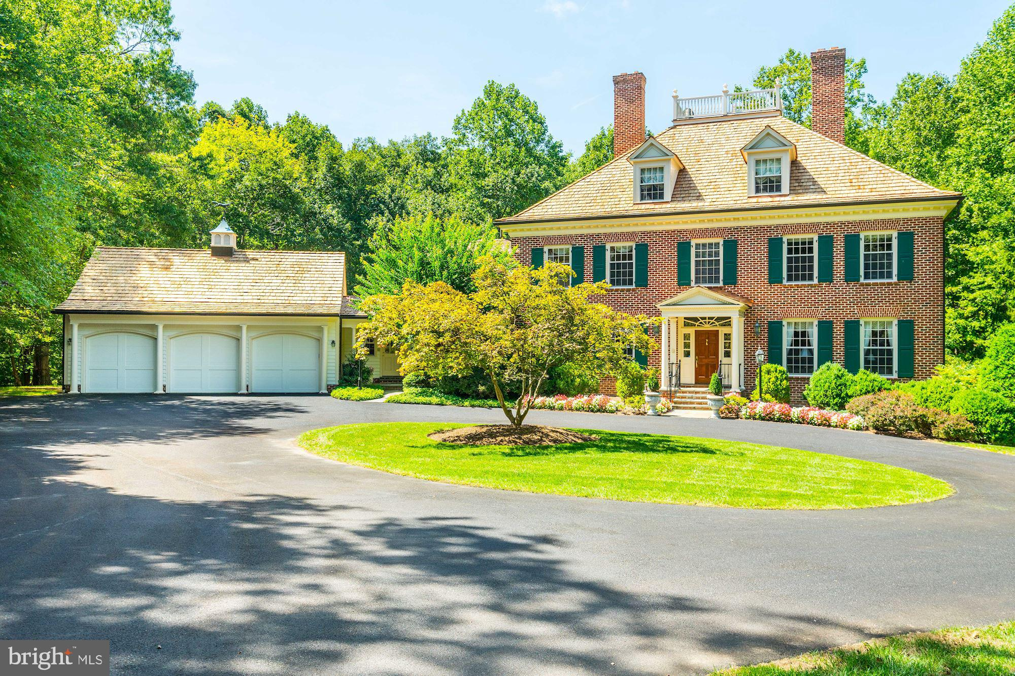 Spectacularly decorated and carefully maintained colonial with unbelievable layout on sought after C