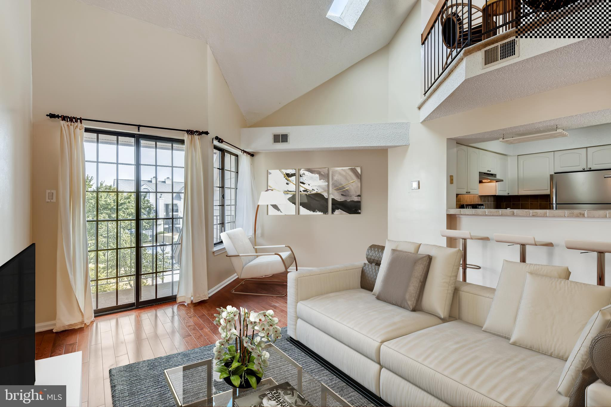 Beautiful, 1 bedroom, 1 bath, loft condo! This contemporary 2 story condo w/loft featuring a generou
