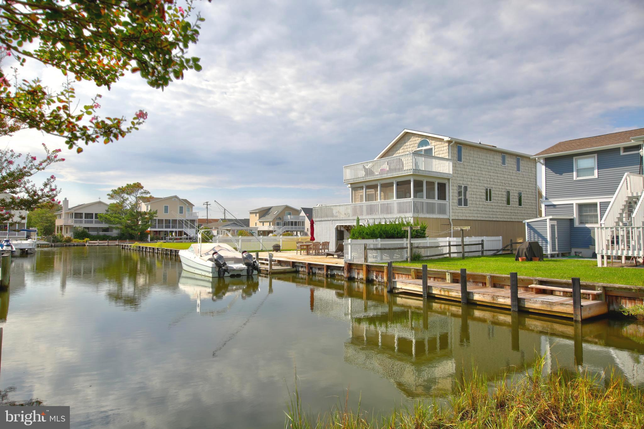 Very rare to the market - a location that provides boating off your private dock yet steps to the be