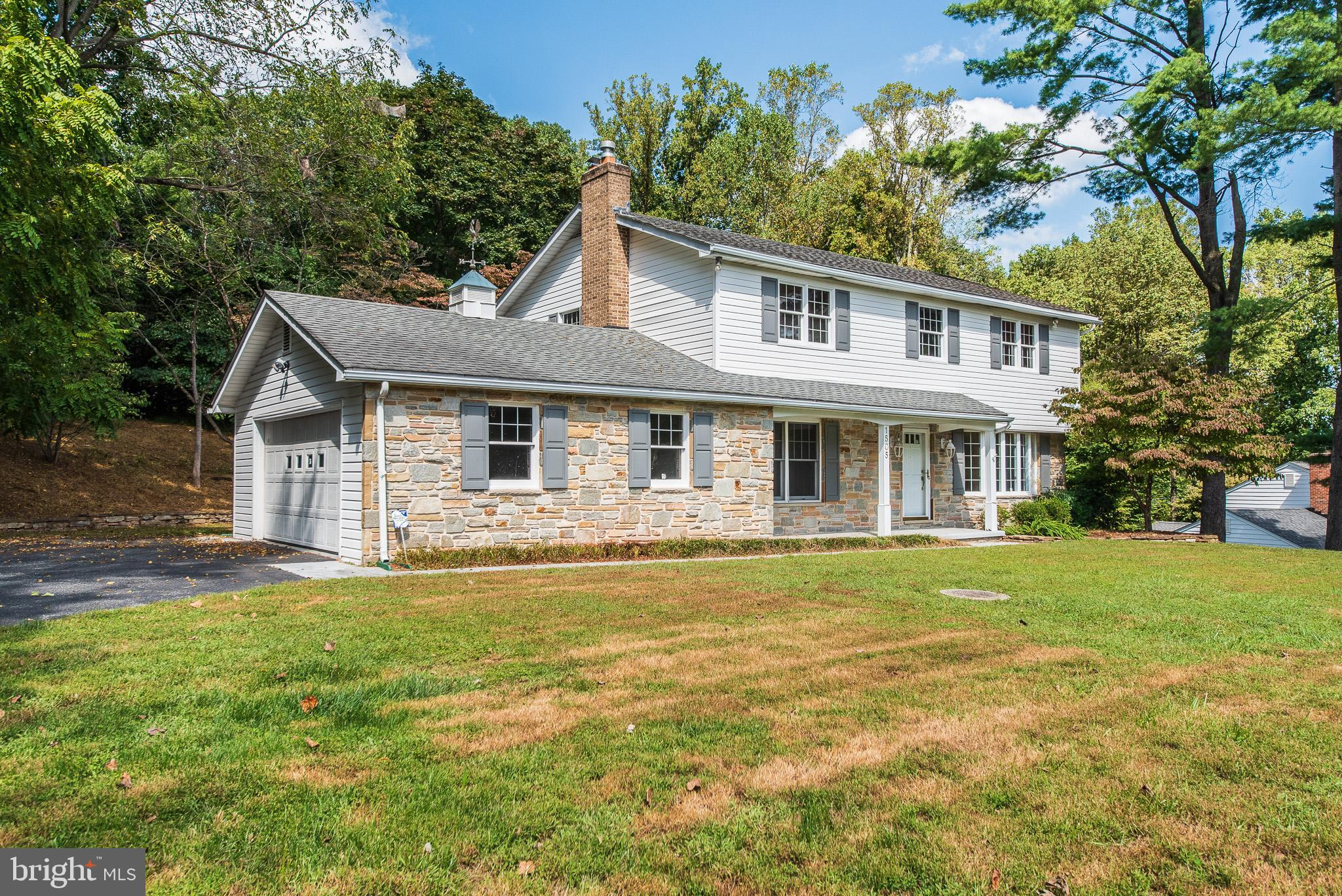 BEAUTIFUL 4 BR 3.5 BA STONE FRONT COLONIAL IN SOUGHT AFTER GLENWOOD IS READY AND WAITING FOR YOU!!