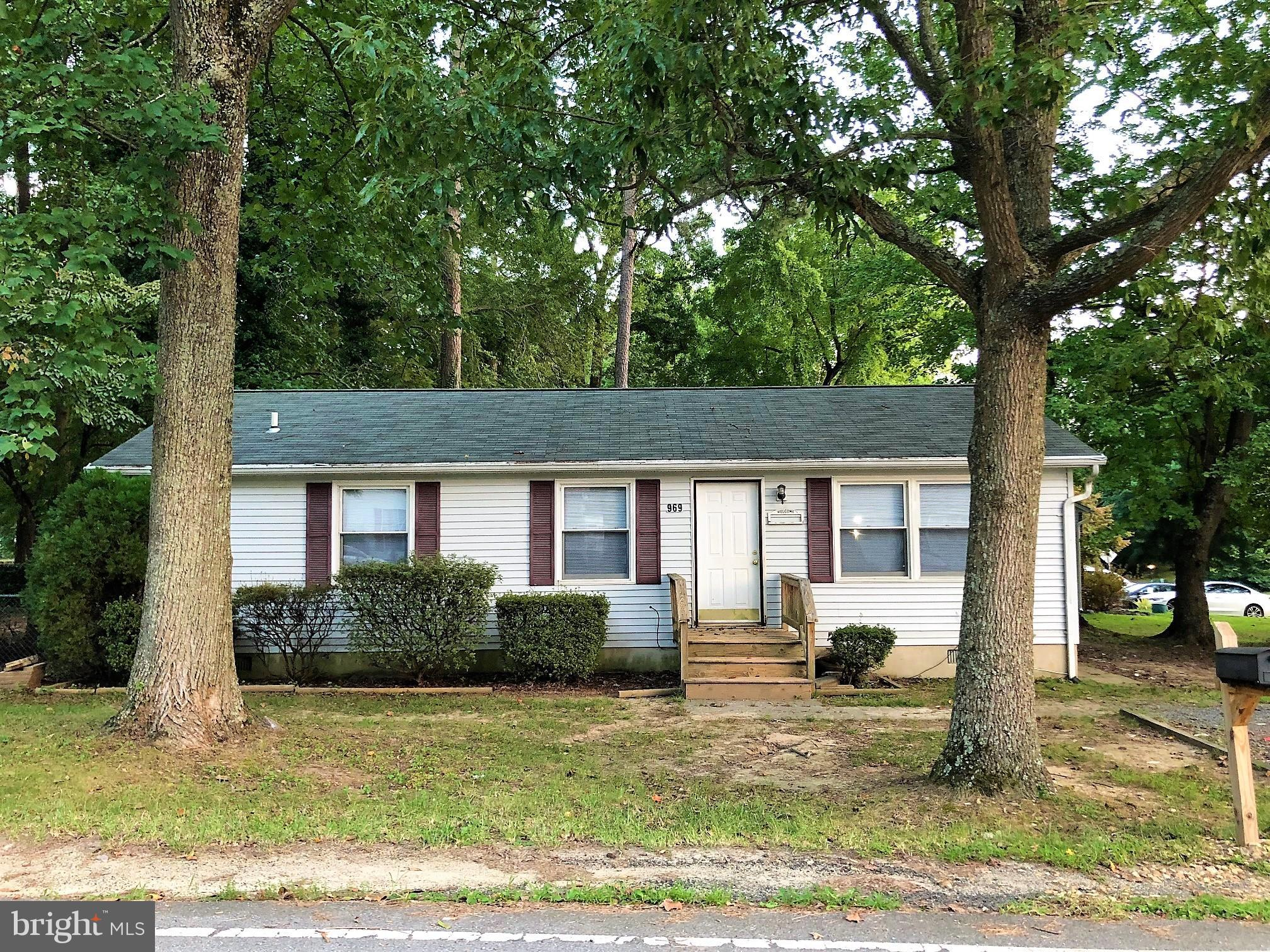 Beautiful & available immediately! Fully renovated 3BR/2BA on large 1/4 acre corner lot adjacent to