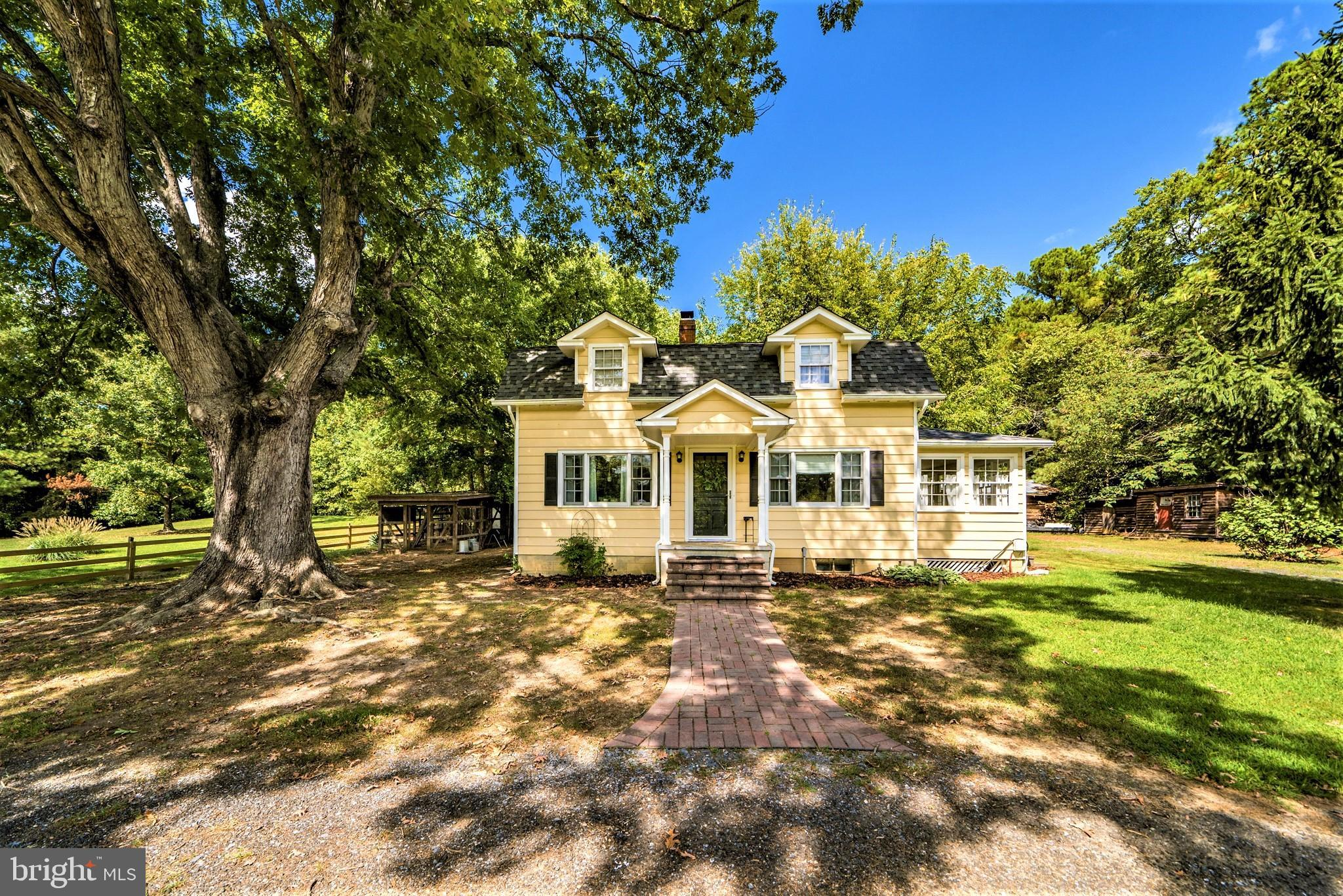 Classic country farmette filled with modern touches and vintage elegance. Set on 5.33 acres of a pre