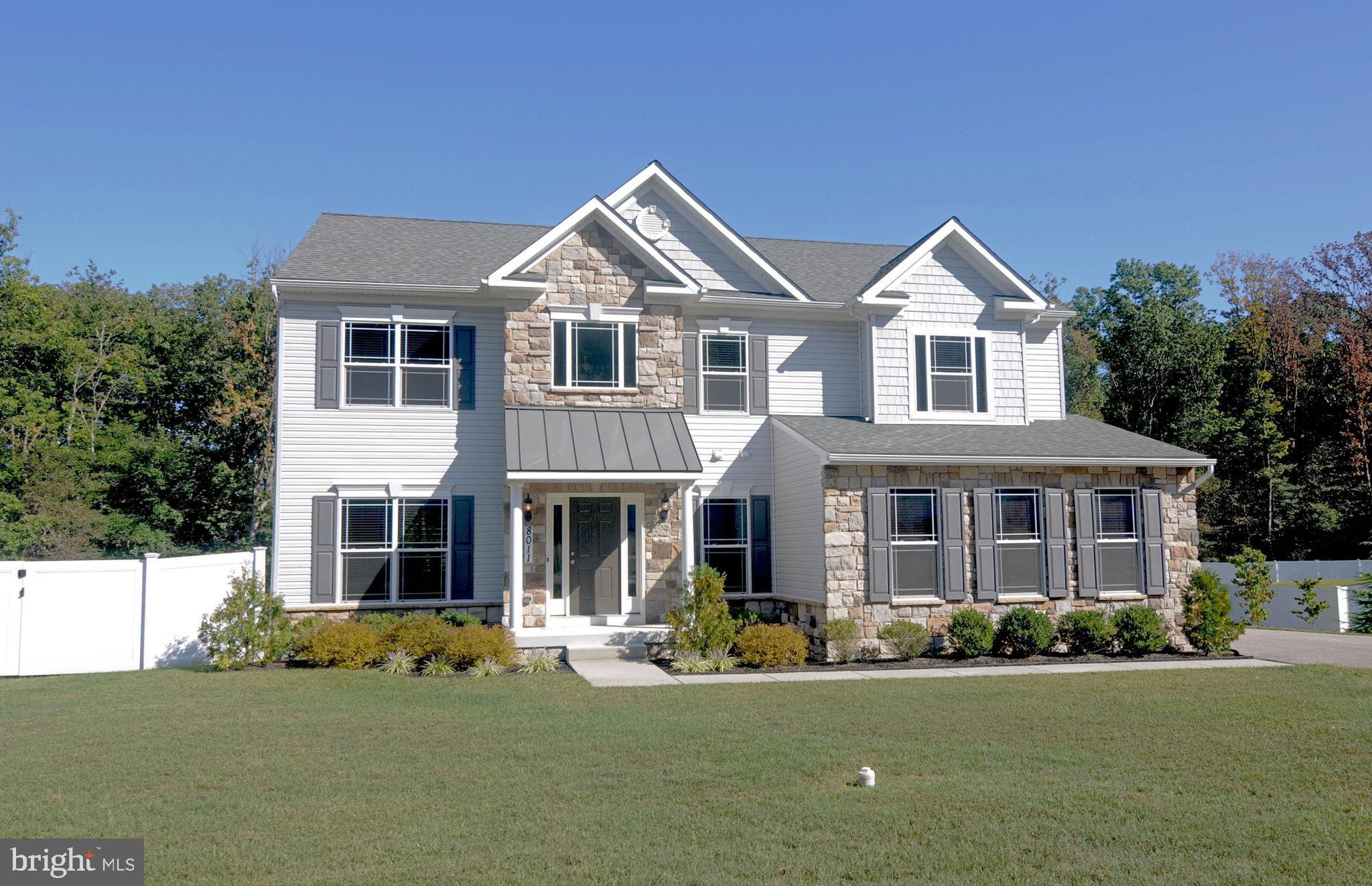 Nearly new colonial sited on a large .55 acre lot. Features a two story foyer. Gourmet kitchen with