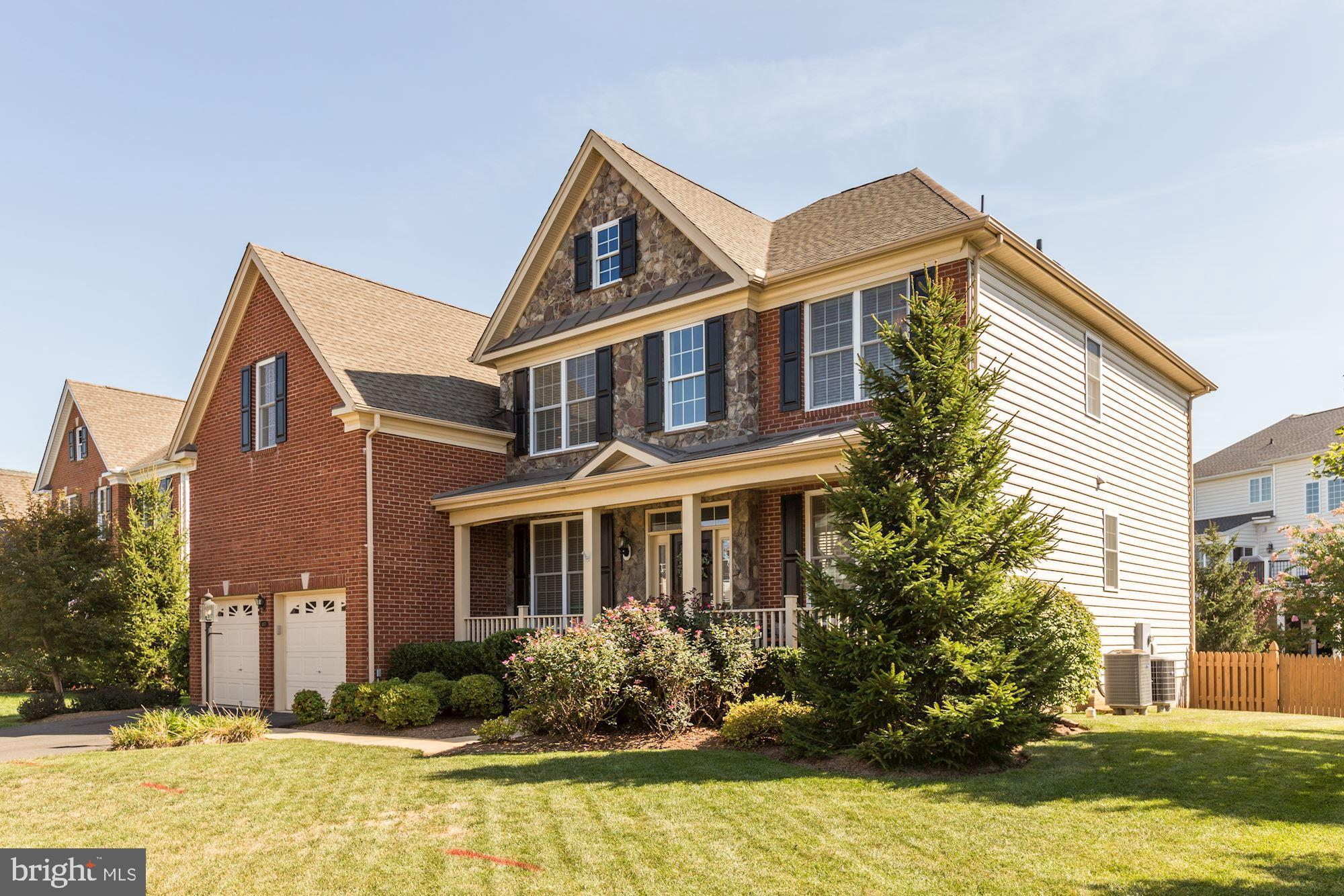 Open House September 22, 2019 from 2-4 P.M.-Incredible Turn Key Masterpiece-Impeccably Maintained and professionally decorated from Top to Bottom-Located on a Quiet Street close to Schools and the Front of the Neighborhood-Regal Stone and Brick Exterior with Front Porch-Professionally Landscaped in the Front and Rear-Large, Flat, Fenced Backyard with Stamped Concrete Patio-Interior Features Include Dark Hardwoods on the Main Level and Upper Hall-Incredible Kitchen with Light Cabinets, Premium Granite, Stainless Steel Appliances, Custom Pendants-Upgraded Lighting Fixture Throughout the Entire Home-Amazing Rear Sun Room off Kitchen-Grand Two Story Foyer and Family Room-Extensive Molding in all Formal Spaces-Spacious Secondary Bedrooms with 3 Full Baths on the Upper Level-Expansive Owner's Suite with Tray Ceiling, Dual Walk-In Closets-and Cozy Spa Like Owner's Bath-The Lower Level Features a Massive Recreation Room, Full Bath and Extensive Storage-All of the Amenities and Security of Dominion Valley and Turn Key Perfection!