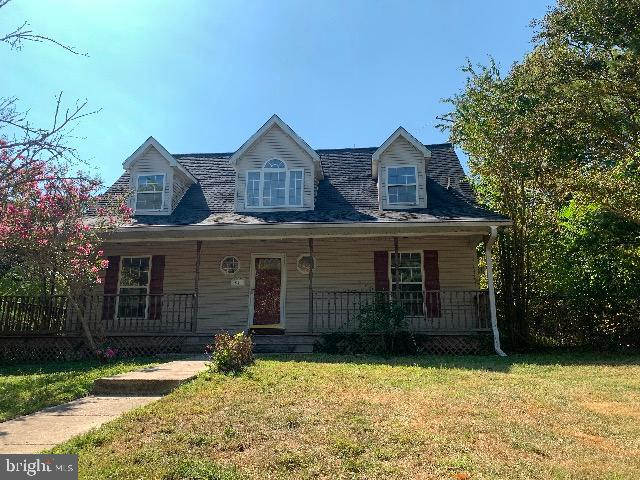 Single family home with new roof; sits on 5 acres with covered front porch and fireplace.