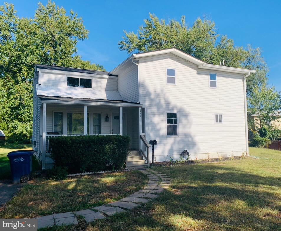 SINGLE FAMILY HOME WITH ADDITION TO TOTAL 3 BEDROOMS & 3 FULL BATHS, FAMILY ROOM CAN BE USED AS 4TH