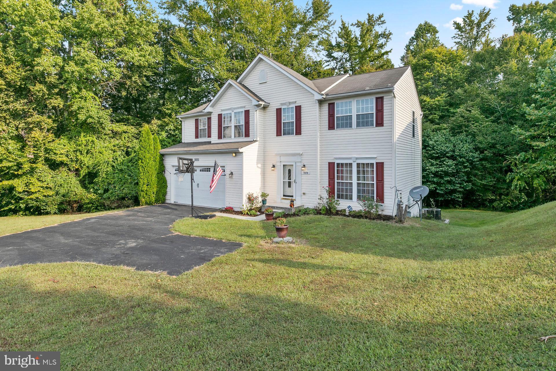 JUST REDUCED, GET YOUR OFFER IN SOON!Charming 2 story: offers 5 large BR's on 2nd level, 2.5 baths & rough-in in the unfinished basement. Sunroom w/skylights offers seasonal living. Trex & vinyl deck off of the sunroom.  Backs to woods, house is located at end of cul-de-sac. Main level offers office w/barn doors, this room can be  restored to the original dining room. New kitchen appliances: flat top stove, refrigerator, garbage disposal & new tile floor.  Kitchen also has cherry cabinets  & 9' ceiling.  Enjoy family living by the wood burning FP.  This home offers upgraded lighting & ceiling fans.  Family room off kitchen has cherry bamboo flooring.  Exterior offers gutter Helmet guards w/lifetime warranty!Great location for family in a great neighborhood: offers basketball courts, tennis courts & playground equipment.  End of cul-de-sac backing to woods;  unfinished basement w/walkout to rear.   There's room for everyone!  Close to Chesapeake Beach & boardwalk!
