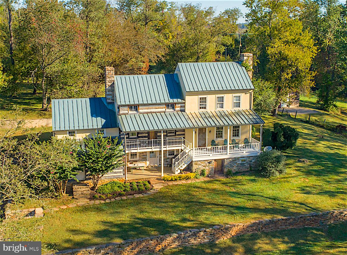 Special offering of this beautiful home and property in the heart of Virginia countryside. This home amazingly enough was built in 1985 using all period materials craftsmanship of ages ago. Built to look old, yet function as new. Building materials include, stone and log walls, 4 stone fireplaces, beautiful wood flooring includes heart pine, oak and maple. Copper roof and gutters.  Newer stainless steel appliances, granite counters, island, sitting area. Wood beamed ceilings. Oversized stone fireplace in dining room. Club room with fireplace. Family room with amazing floors and fireplace. Four ample size bedrooms. Three levels over 3200 sqft. Home perfectly sited on 11+ acres with stocked pond. Oversized 3 car garage and finished guest home above, with 2 bedrooms and full bath, large kitchen and family area. Heat pump HVAC. Loft above that for storage. Separate shed/Gym/workshop with heat/electricity. Additional 6.9 acre lot can be made available that has a wonderful house site and views. Great lot for animals and ride out potential.  Appointment only because of dog. No lock box. Driveway starts at The Shades sign.