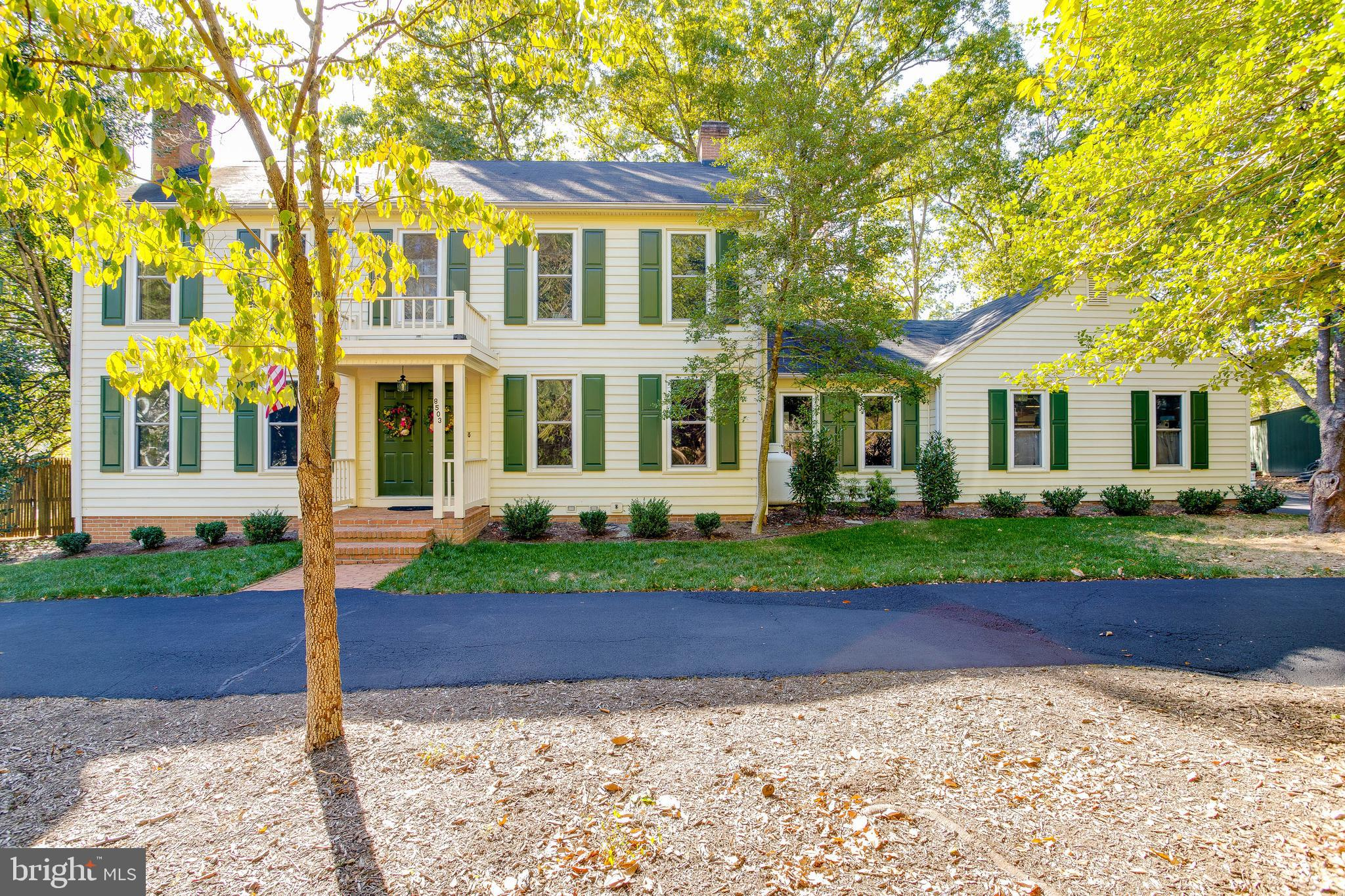 Beautiful Center Hall Colonial On Over an Acre! Hardwoods throughout Main Level, Formal Living Room,