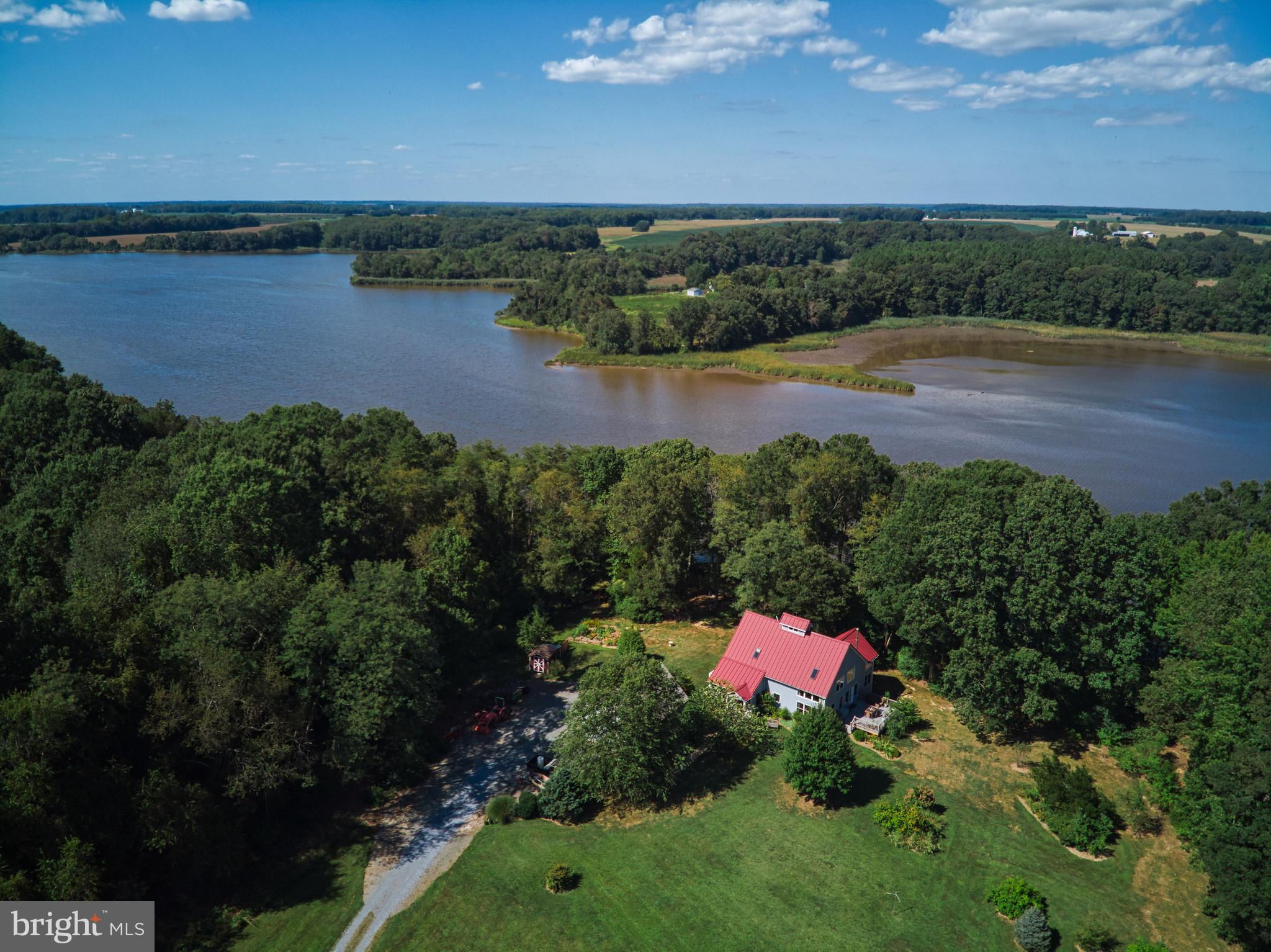 Perched on the banks of Southeast Creek and tucked away on over 9 acres, this property is a nature l