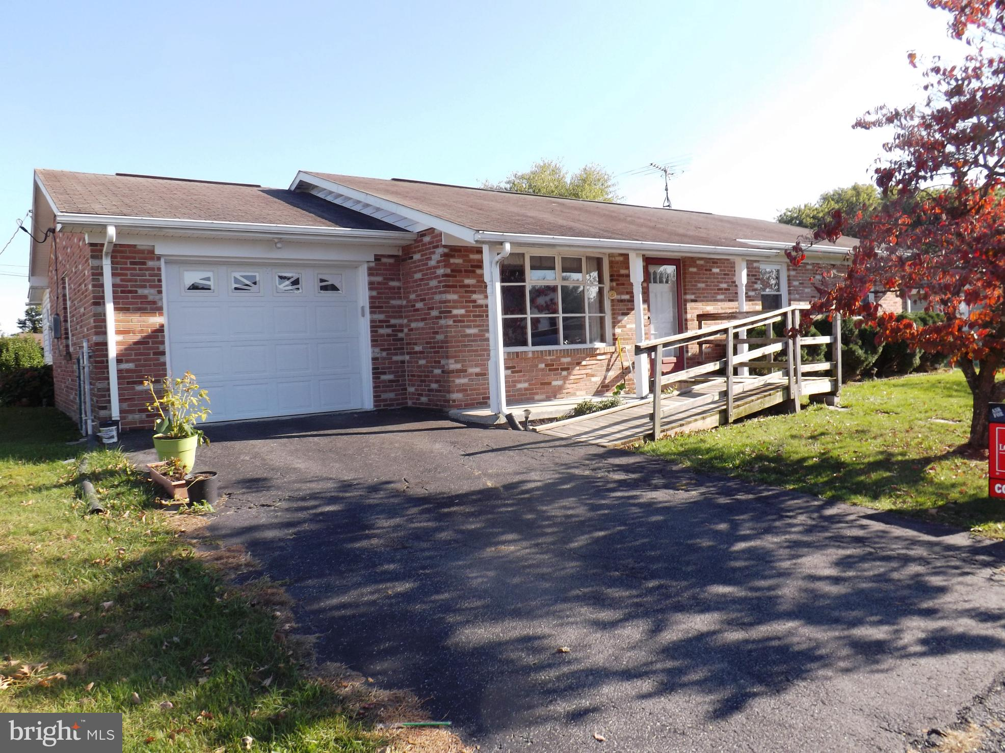 Nice Brick Rancher that is 3 bedroom 1 1/2 bath with full unfinished basement. Hardwood flooring in
