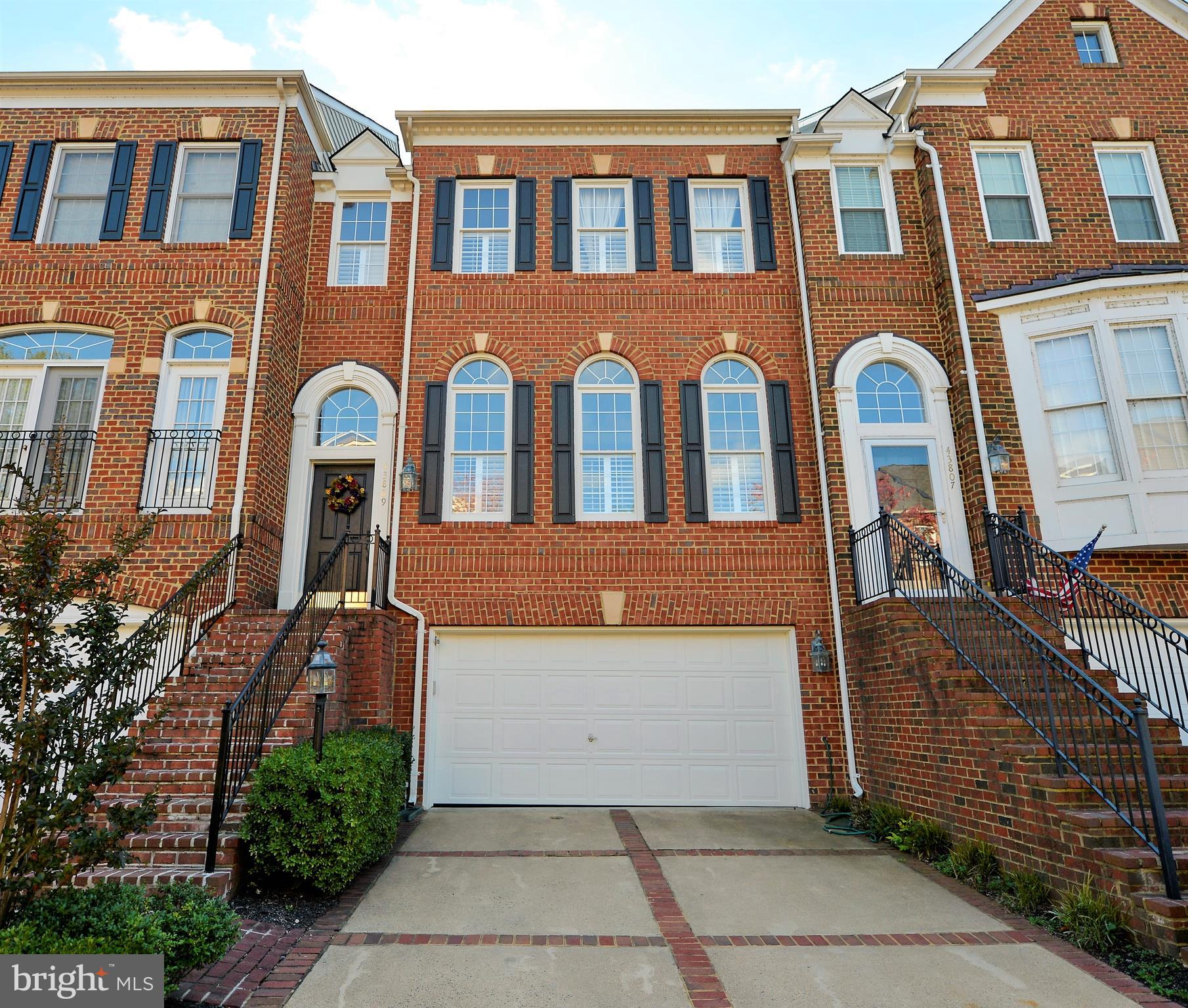 Gorgeous Town home on 4 finished levels in the River Creek Community!  Gleaming Hardwood floors, gas