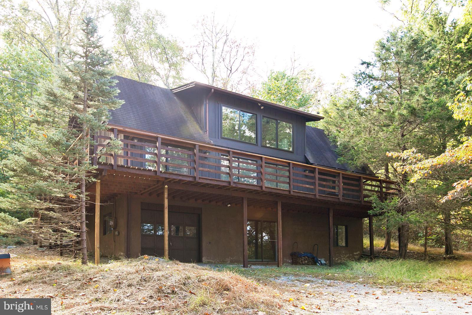 This charming oasis in Bluemont sits on 13.6 wooded acres and borders a NationalForest. It~s the per