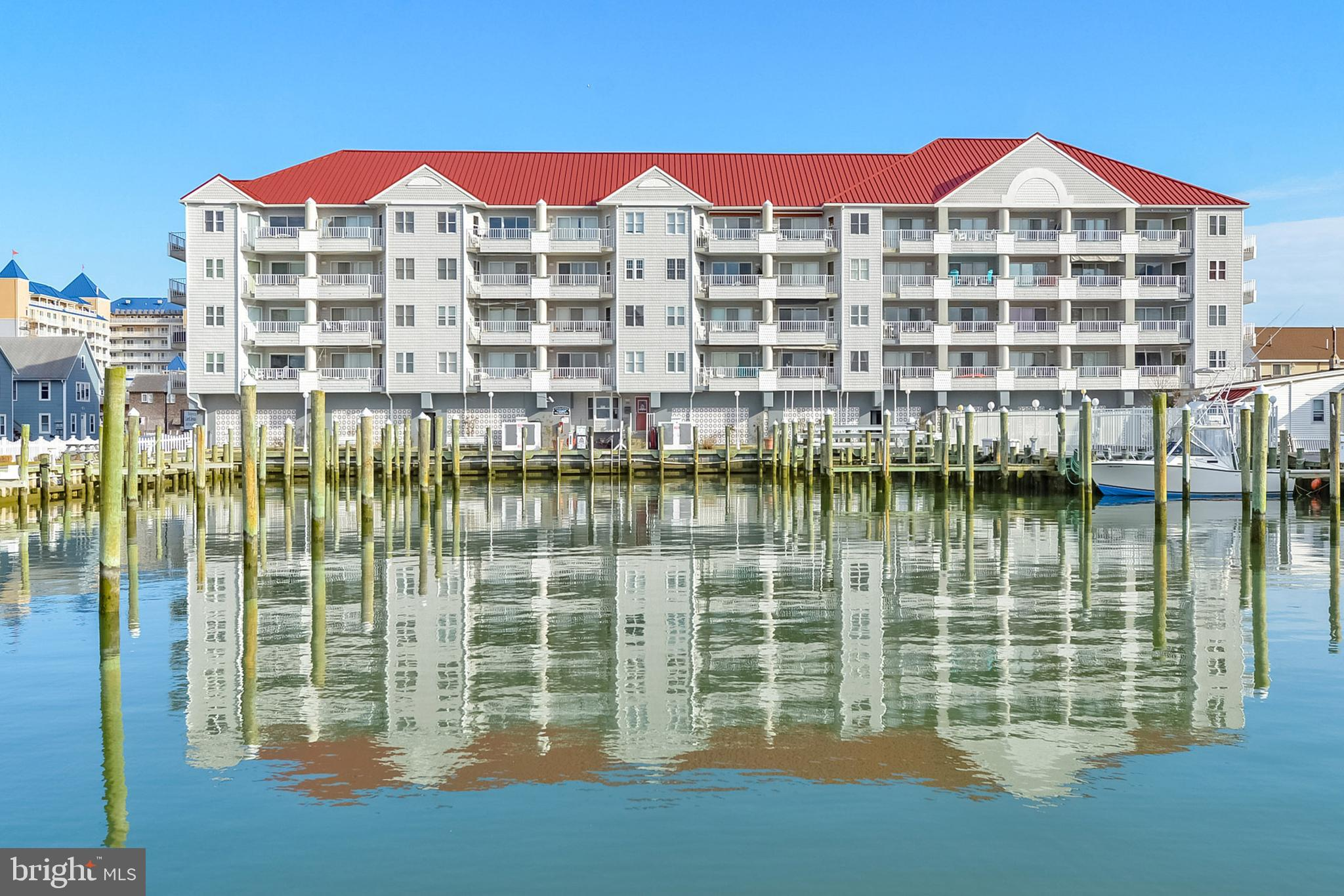 White Marlin #B306 is a lovely condo situated right on the White Marlin Marina in the heart of Downtown Ocean City. As far as location goes, you can't beat this one! The beach, boardwalk, shops, dining, and more are in very close proximity. The condo features two bedrooms, two bathrooms, and an open floor plan with plenty of dining and living space. Step out onto the private balcony overlooking the marina and Assawoman Bay providing fantastic sunset views! Boat slip #29 conveys with this property, dimensions are 65' by 22', perfect for any large boat! Property also features two great assigned parking spaces, one under the building right near the elevator and one oustide right near the pool. Right outside your front door, the White Marlin Marina is not only a great place to dock your boat, it is also a hub for the world-famous White Marlin Open. The community is well maintained and offers an elevator and a bayside, outdoor pool. If you're looking for your own personal boaters paradise or a rental income-producing investment, White Marlin #B306 is a great option for you! Annual gross rental income around $29,000.