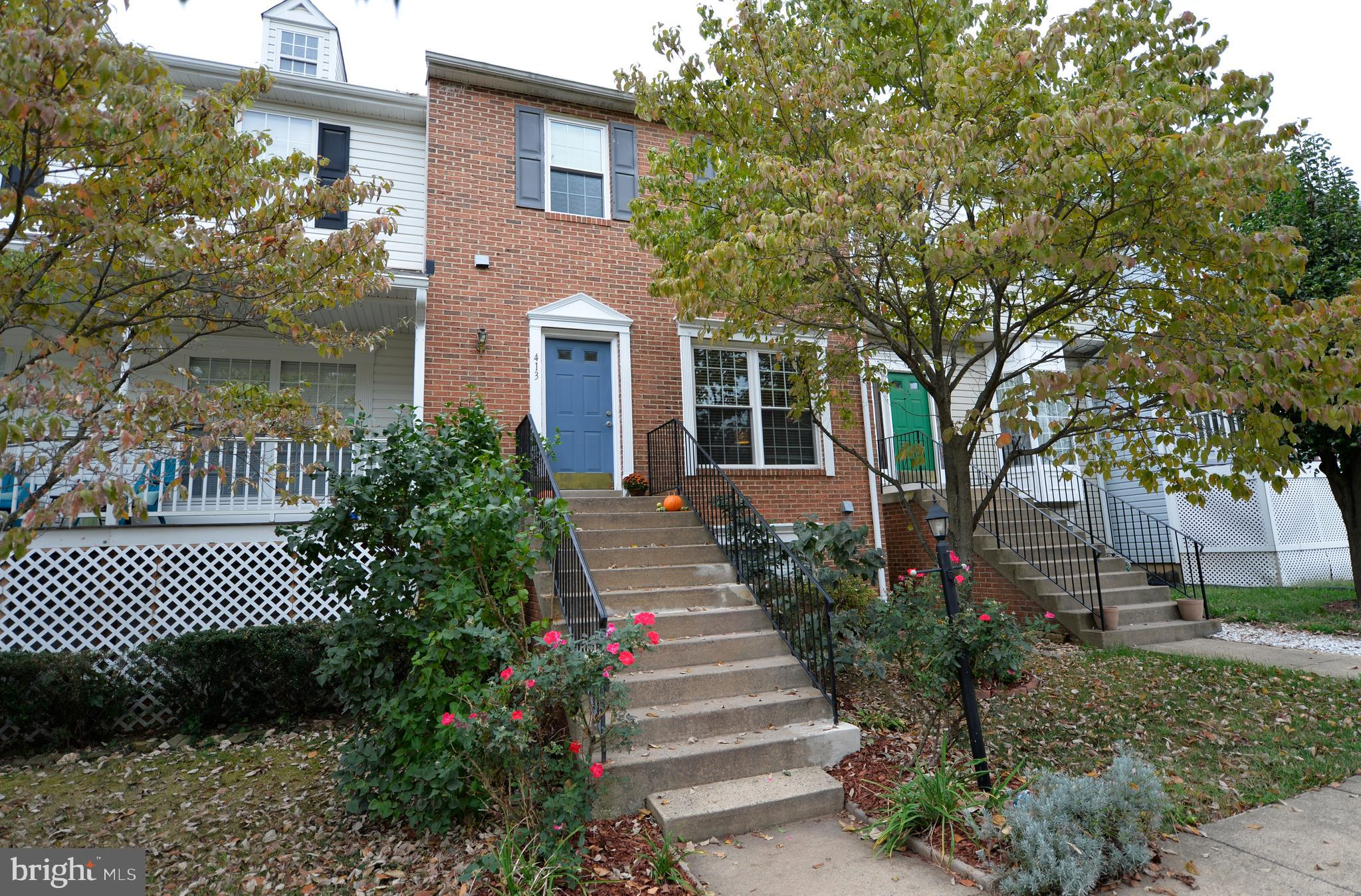 Exceptional townhouse with updates that include kitchen, roof, windows and flooring! You will fall i