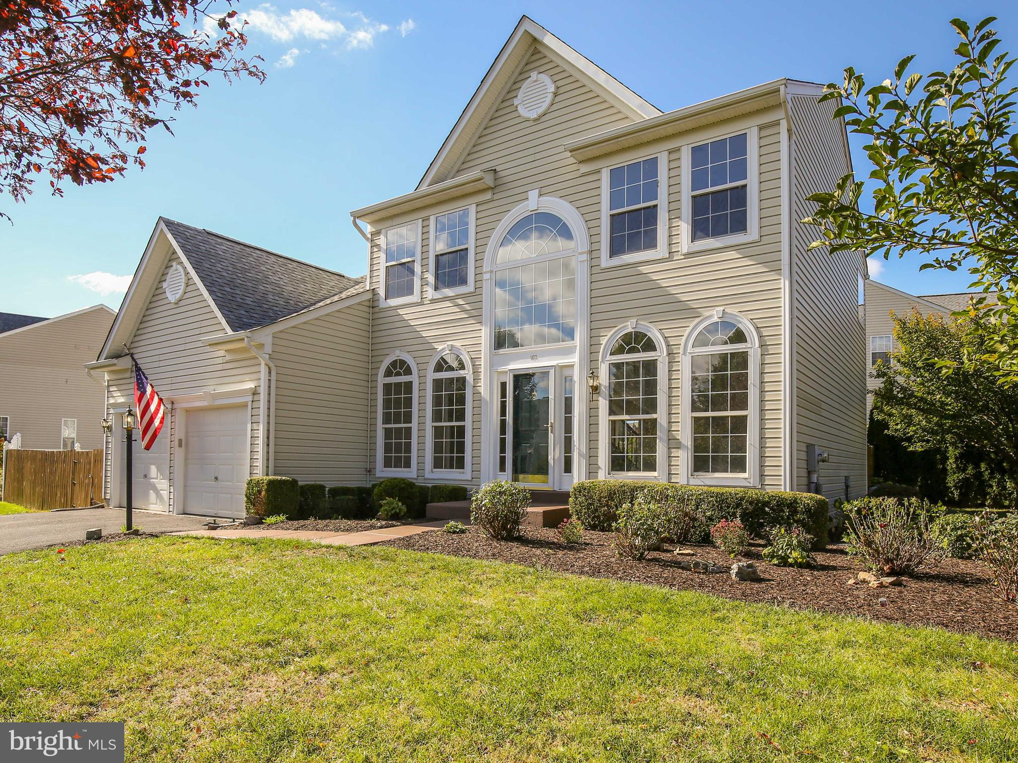 Handsome Colonial on premium corner lot in a community of treelined streets and mature landscaping.