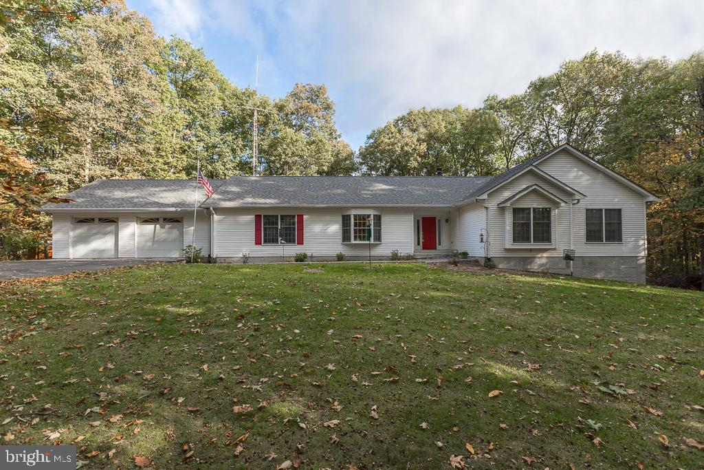 Location and layout of this home is fantastic! Large rancher offers almost 2,600 Square feet of livi