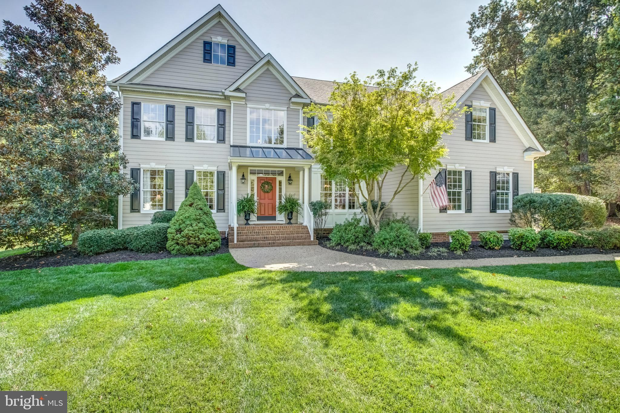 Meticulously maintained, transitional style home built for it's current owners offers wonderful curb